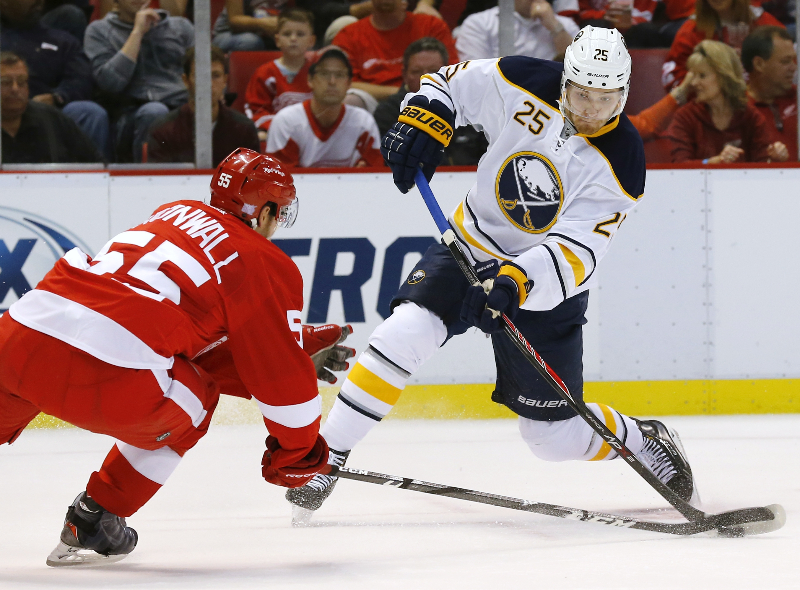 Buffalo Sabres center Mikhail Grigorenko (25), of Russia, shoots as Detroit Red Wings defenseman Niklas Kronwall (55), of Sweden, defends during the first period of an NHL hockey game in Detroit, Wednesday, Oct. 2, 2013. (AP Photo/Paul Sancya)