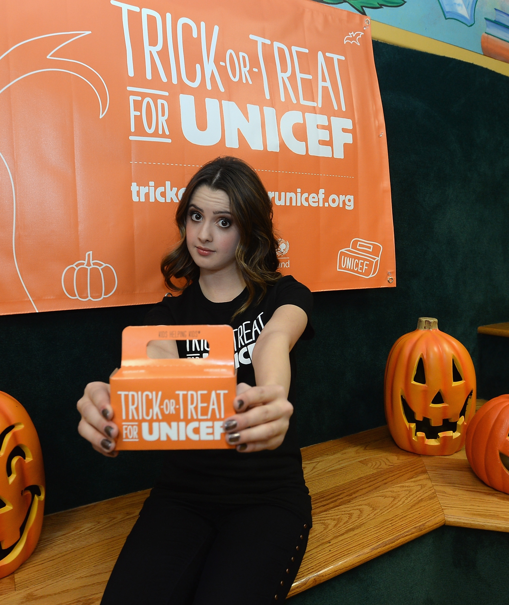 Spreading the word: Actress Laura Marano visits with students from Glassel Park Elementary School on behalf of Trick-or-Treat for UNICEF on Tuesday in Los Angeles.