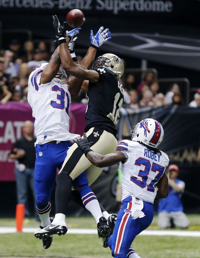 Buffalo Bills free safety Jairus Byrd (31) and defensive back Nickell Robey (37) break up a pass intended for New Orleans Saints wide receiver Marques Colston (12) during the first half. (AP Photo/Bill Haber)