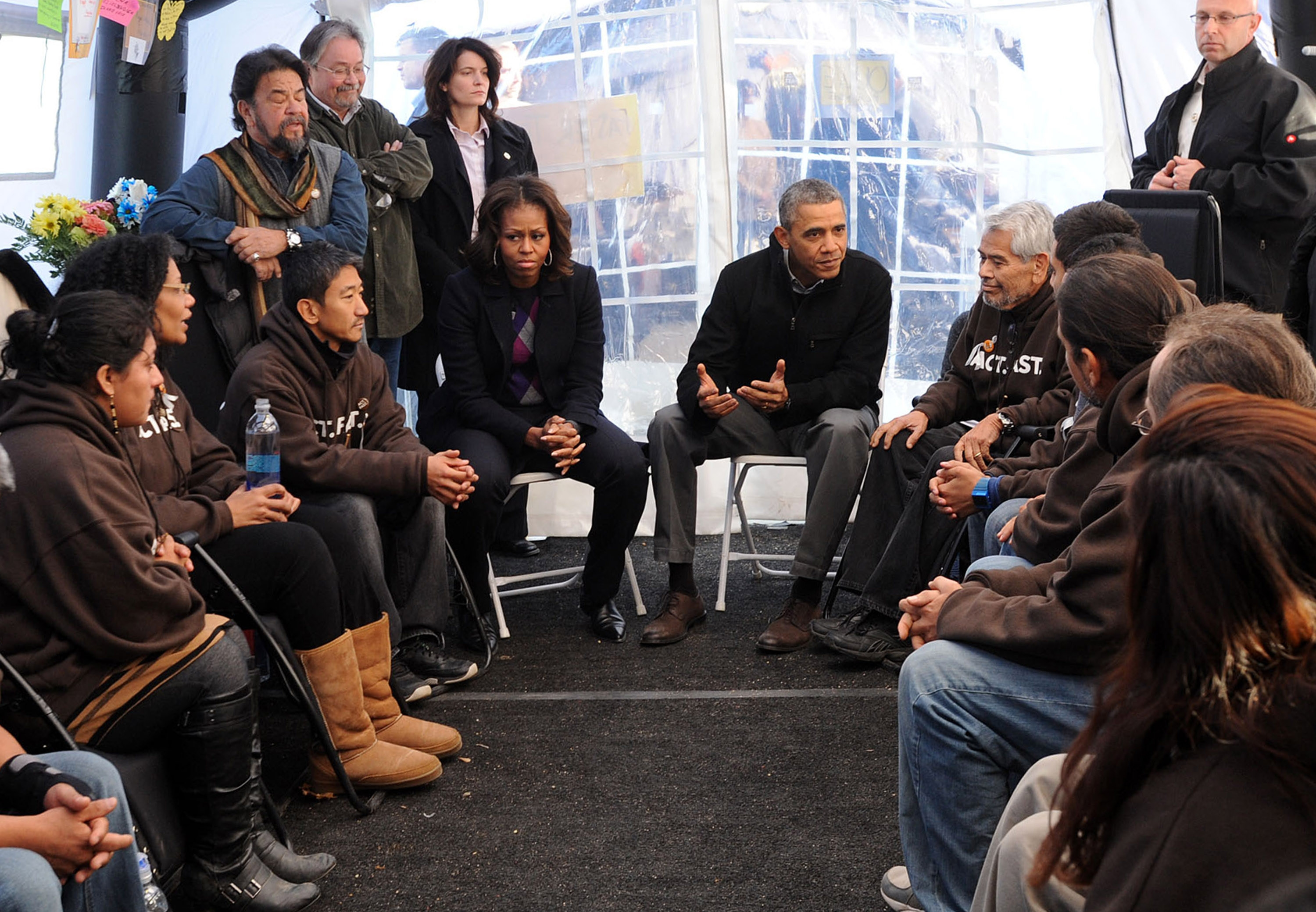 President Obama and his wife, Michelle, meeting Friday with those on a hunger strike on the National Mall, voiced concerns for the strikers' health.