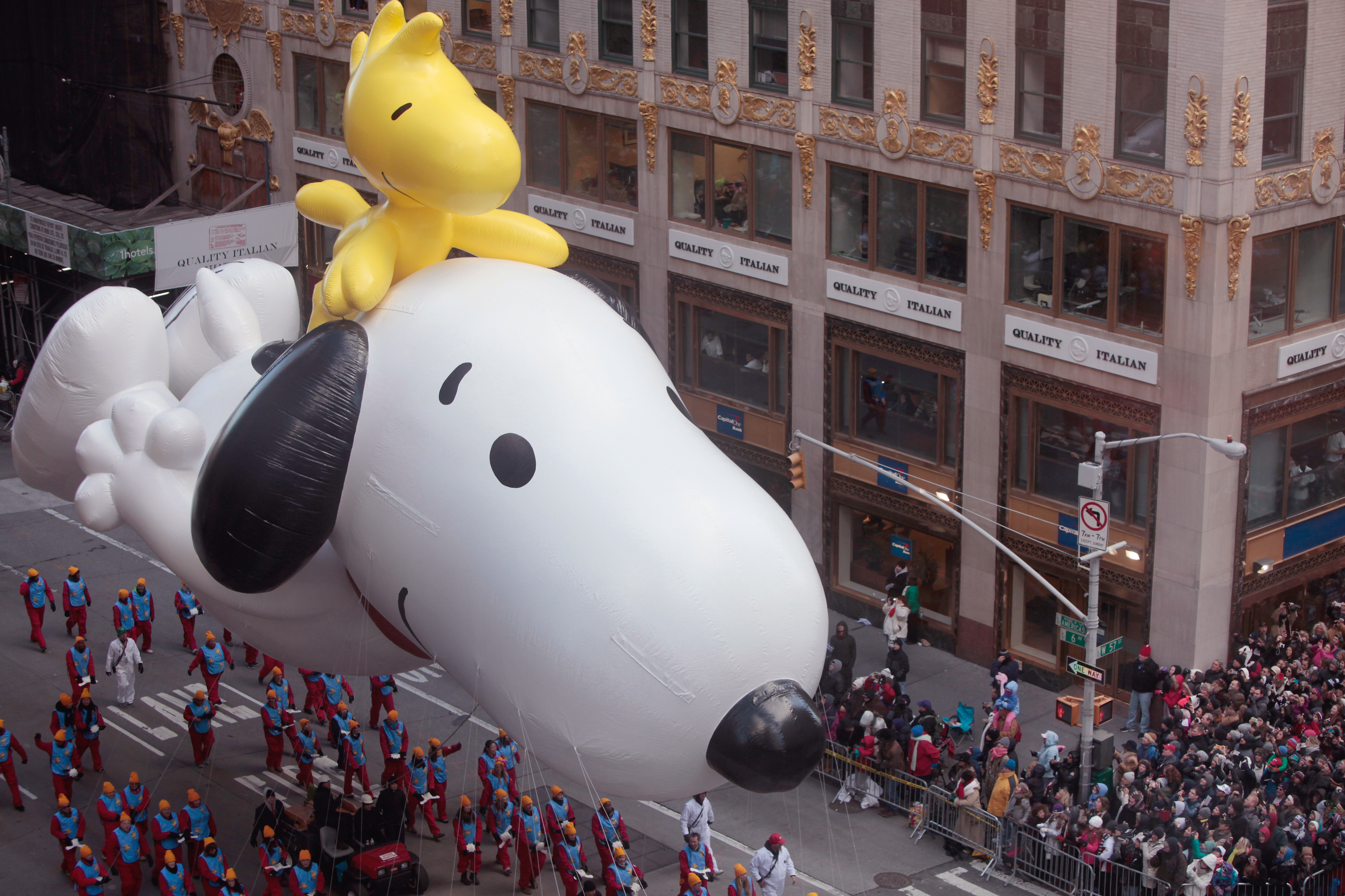Snoopy and Woodstock float along in Macy's Thanksgiving Day Parade. Despite fears of high winds, the giant balloons made their annual march. For a gallery of the Macy's Thanksgiving Day Parade, go to <a href=