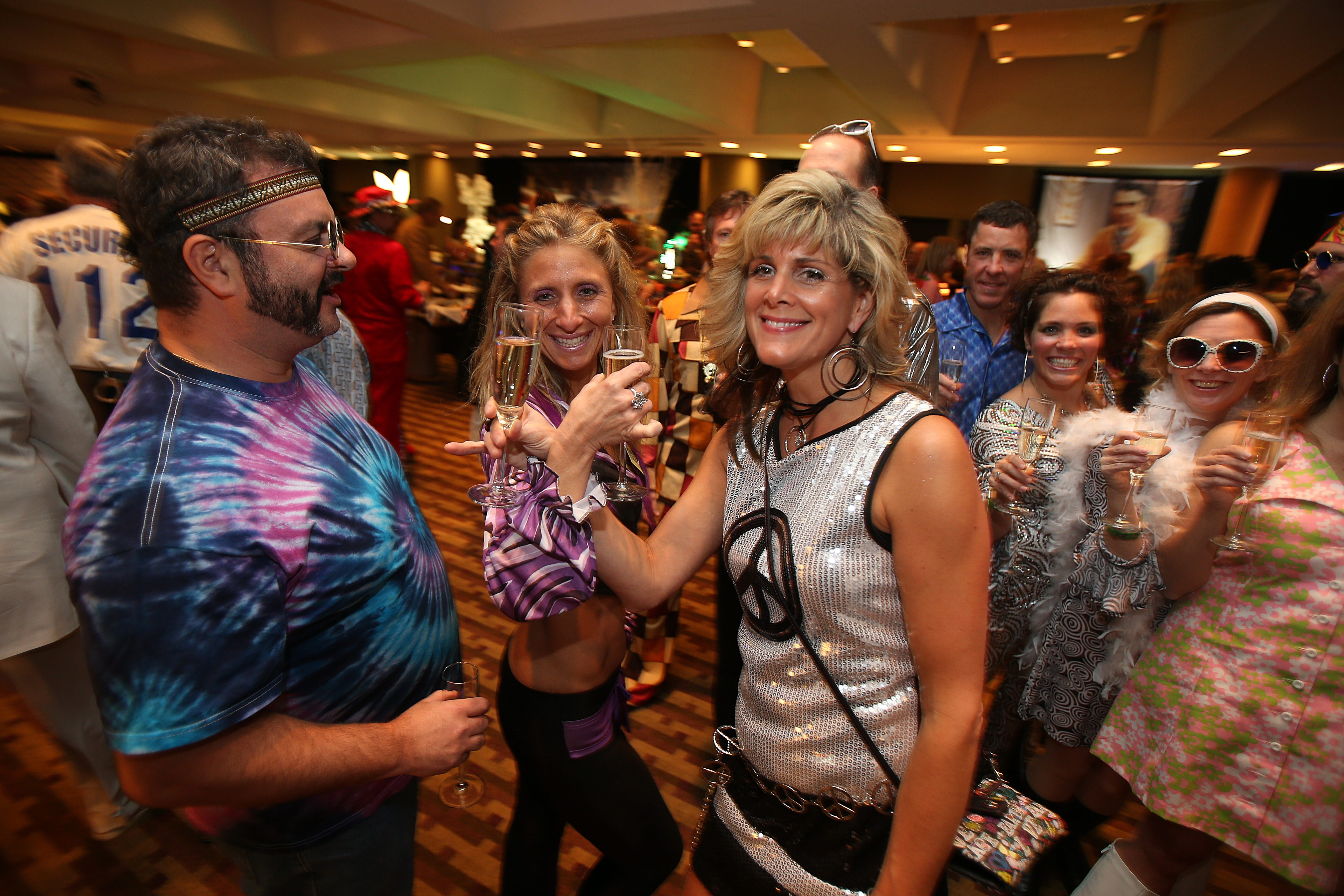 From left, Shawn Shelton, Colleen Shelton and Jodi Ross, all of Clarence Center, are primed for fun at the World's Largest Disco, at the Buffalo Niagara Convention Center in Buffalo on Saturday.