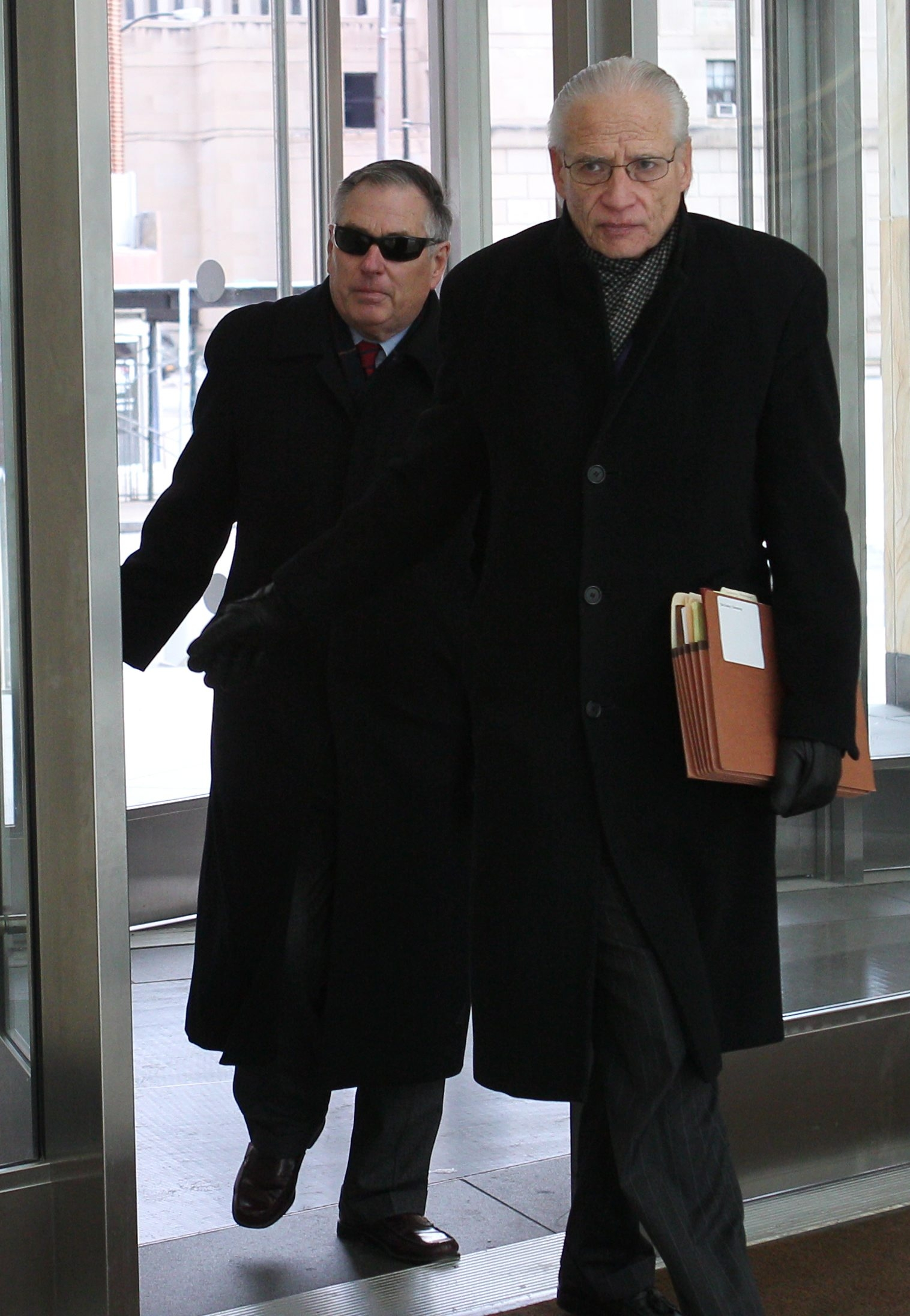 Tim Toohey, left,  enters federal court with his lawyer, Joel Daniels, for sentencing Monday.