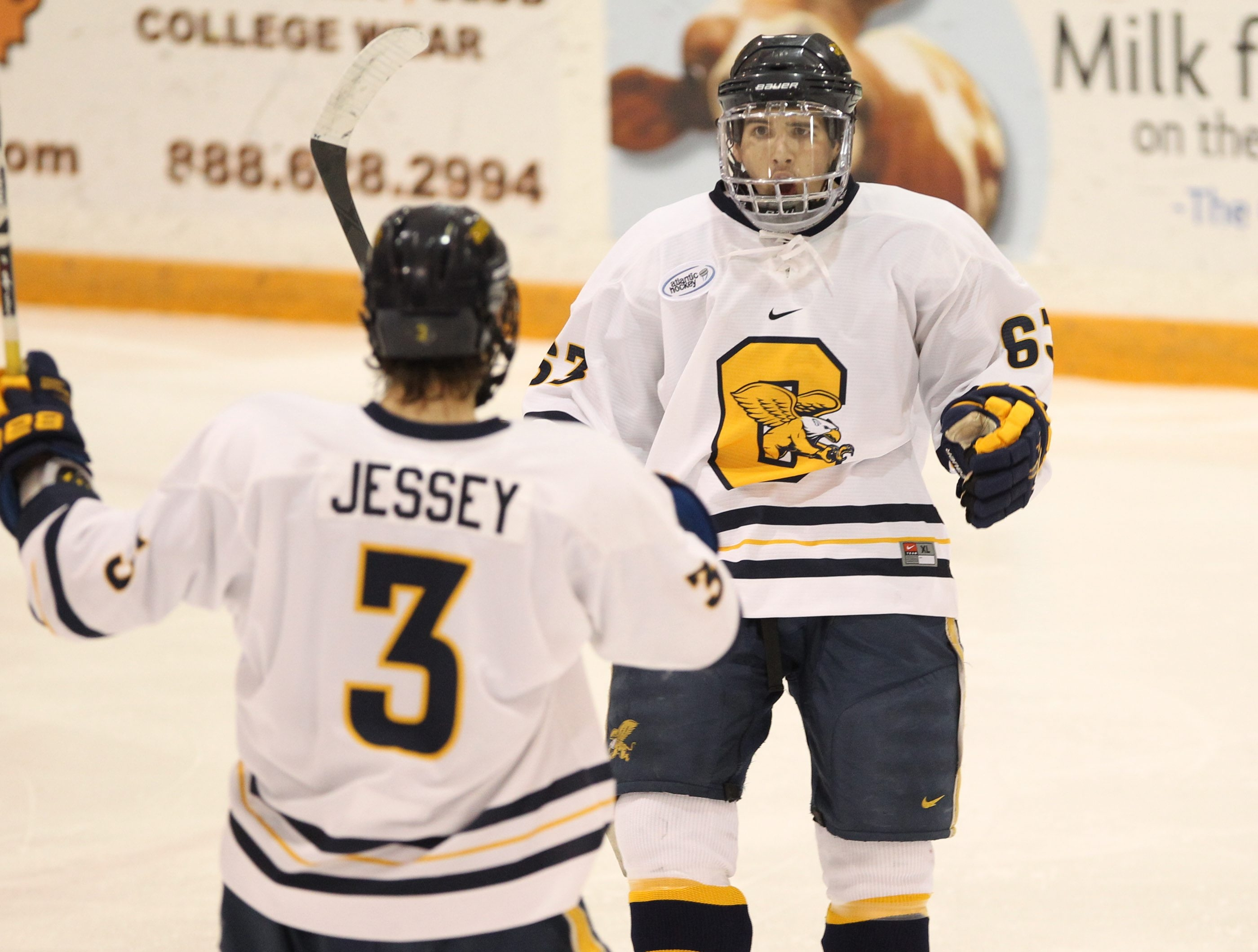 Doug Jessey of Canisius celebrates with teammate Shane Conacher after scoring a goal in the Griffs' 2-2 tie with UConn.