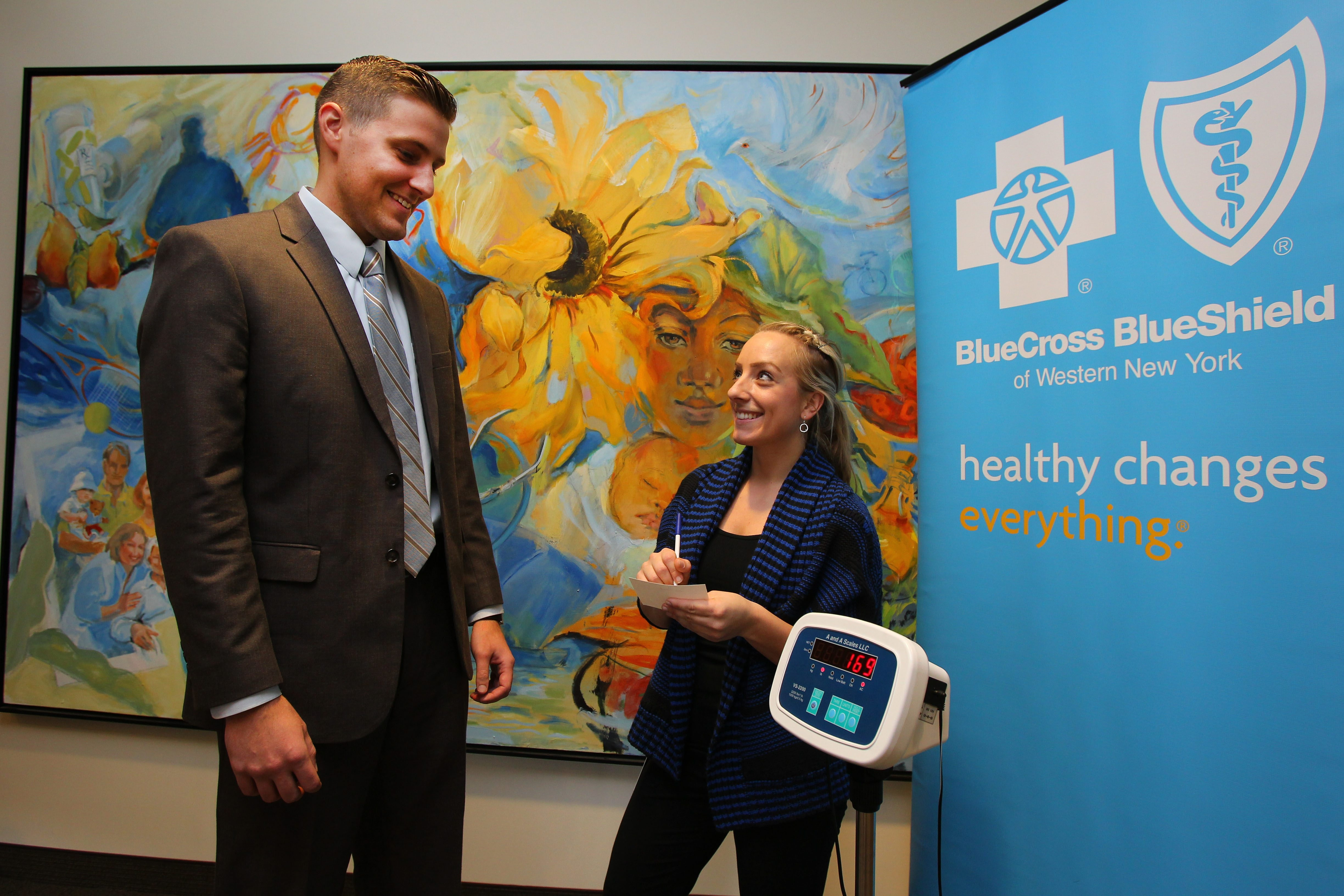 Dave Malczewski gets a pre-Thanksgiving weigh-in Tuesday from Grace Jackson at the BlueCross BlueShield headquarters in Buffalo.
