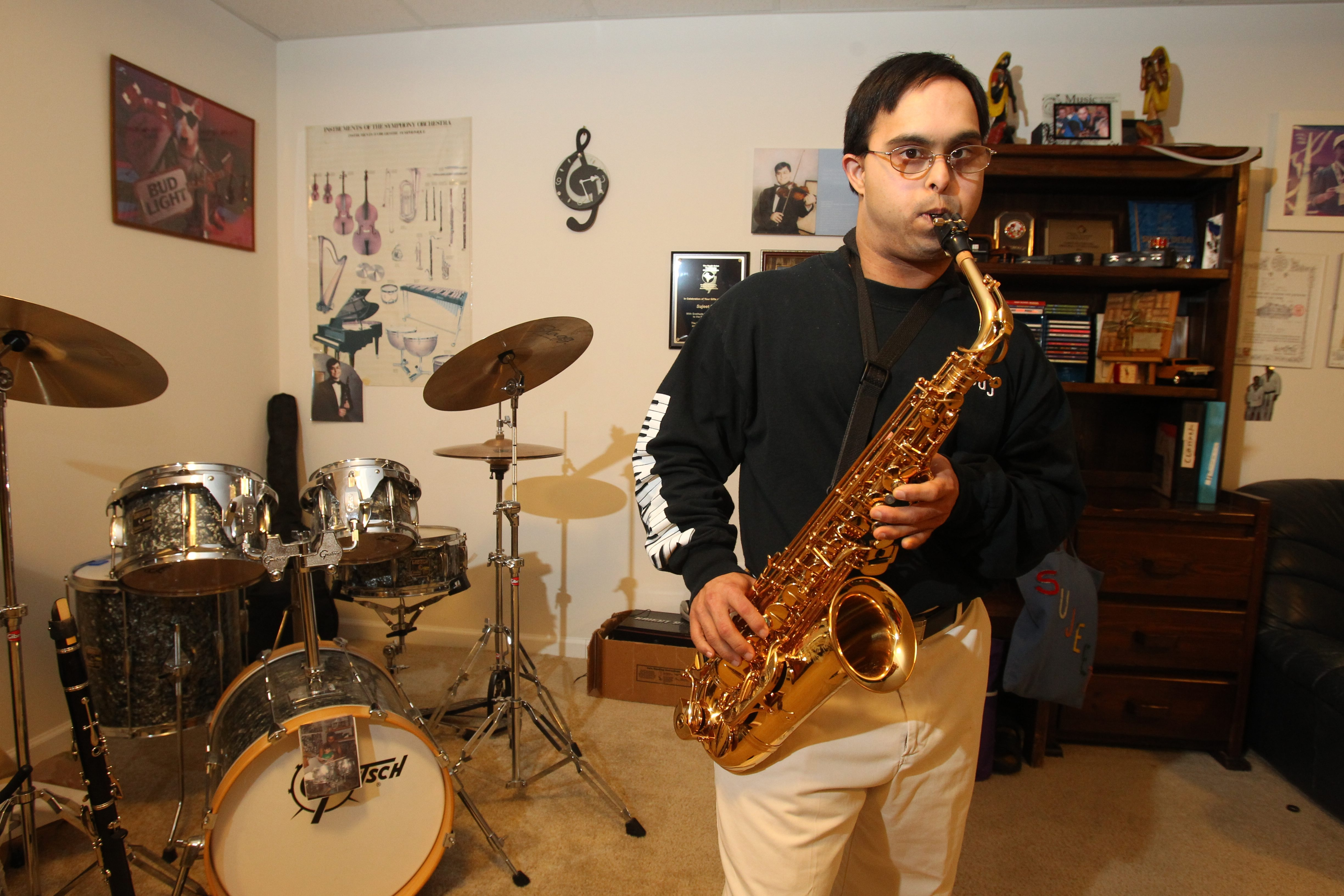 """Sujeet Desai, 32, plays saxophone and six other musical instruments. He has won medals at the World Summer Special Olympics and has traveled the world. He says, """"The main thing is not to give up."""""""