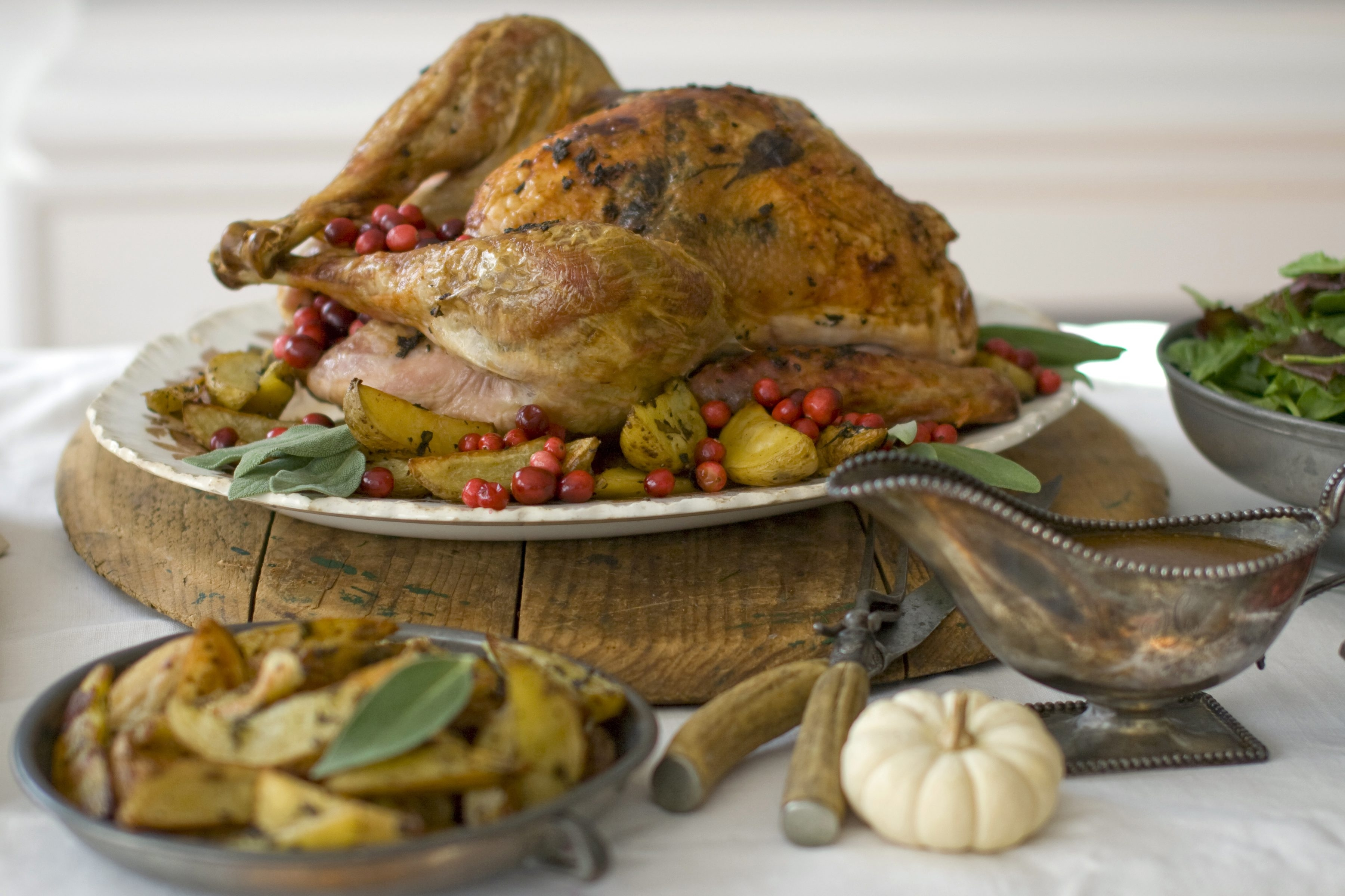 Eating in the afternoon and limiting alcohol are two things you can do to reduce heartburn after Thanksgiving dinner.