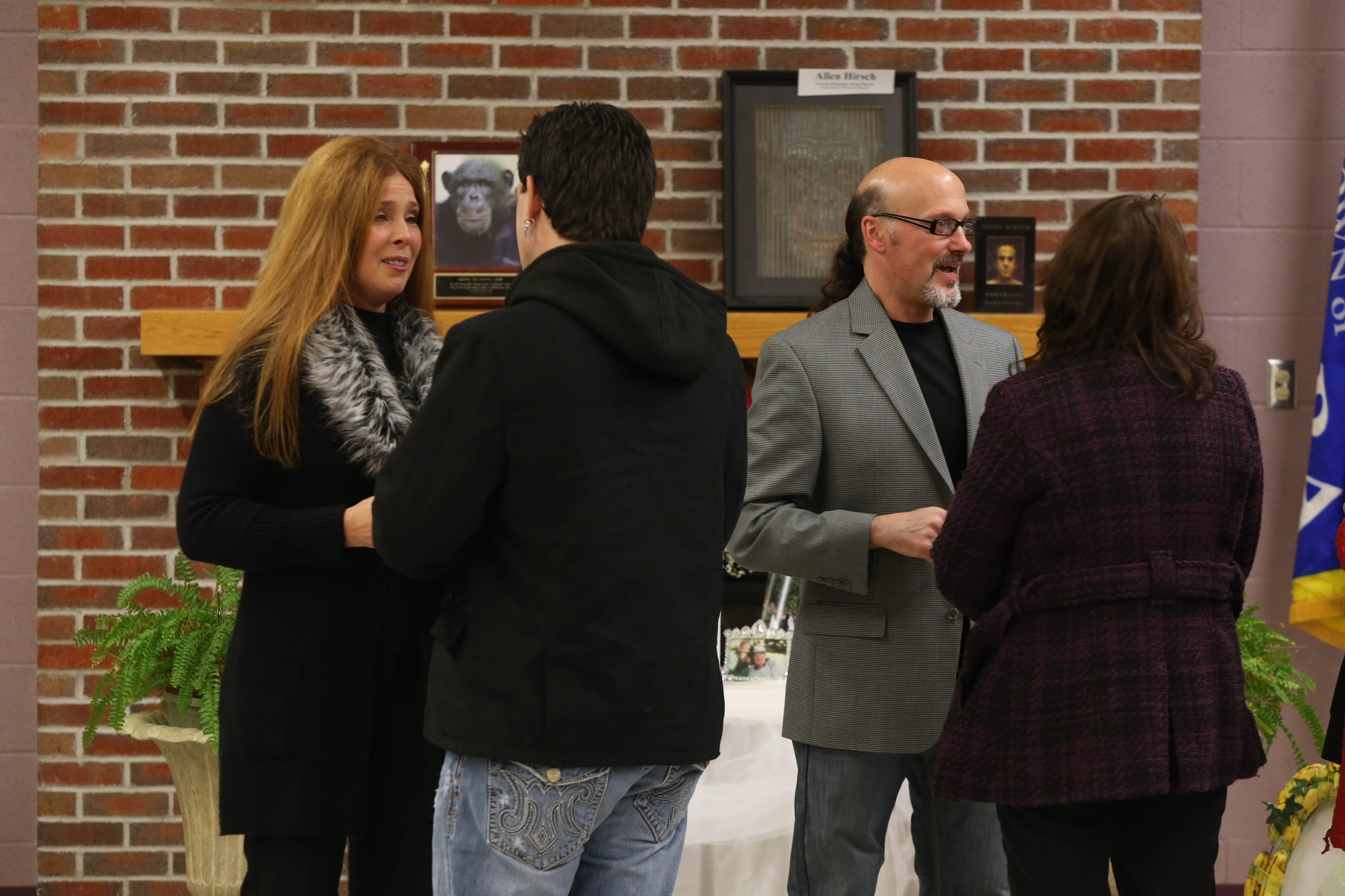 Carmen and Christie Presti receive well wishers at a memorial service for Charlie the Chimp at the Town of Niagara Senior and Youth Activity Center in Niagara Falls on Sunday.