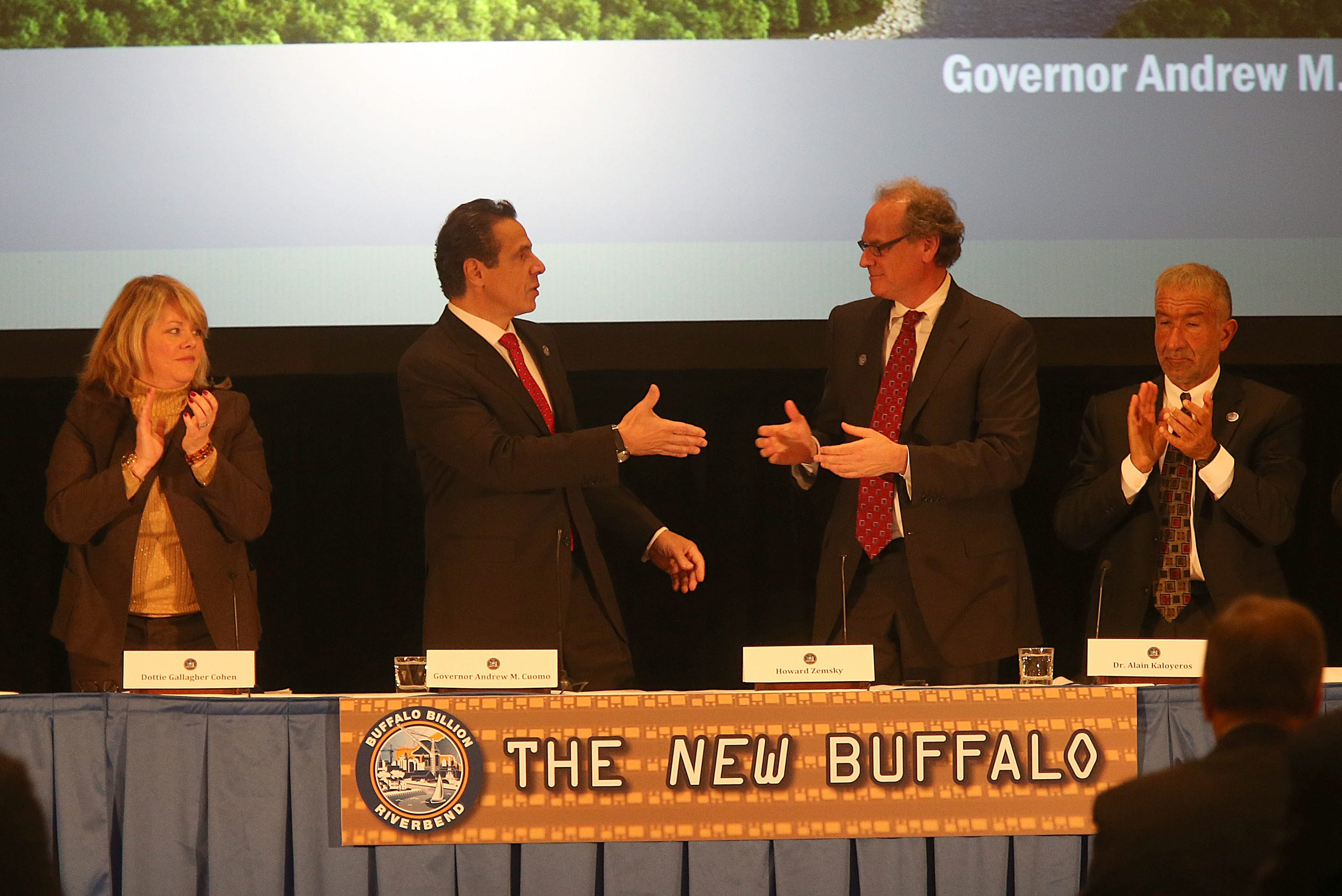 Gov. Andrew M. Cuomo congratulates Howard Zemsky at Thursday's announcement that the state will invest $225 million to build the Buffalo High-Tech Manufacturing Innovation Hub.