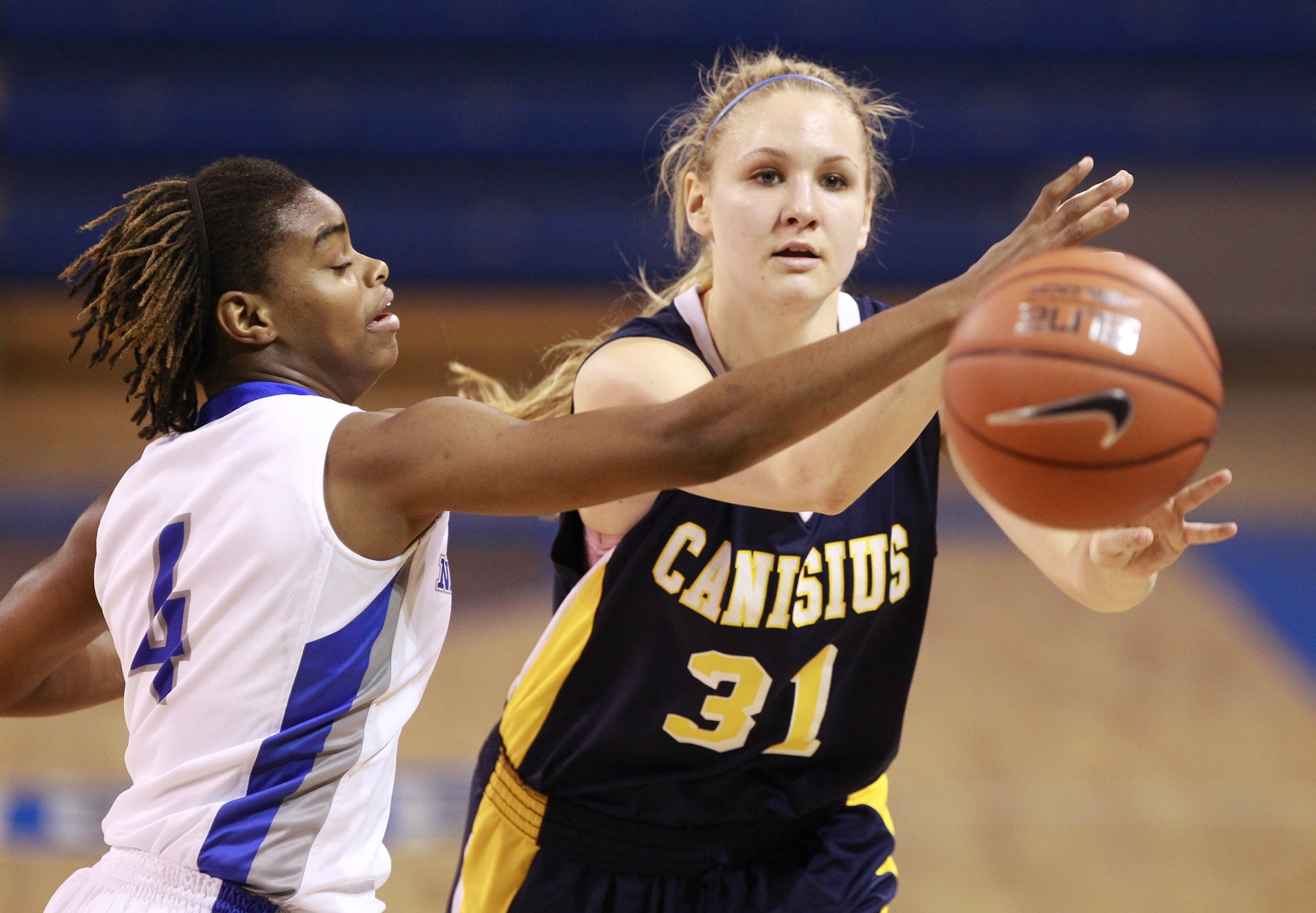 UB's Joanna Smith deflects a pass by Canisius' Emily Weber during the Bulls' 68-59 victory Wednesday night.
