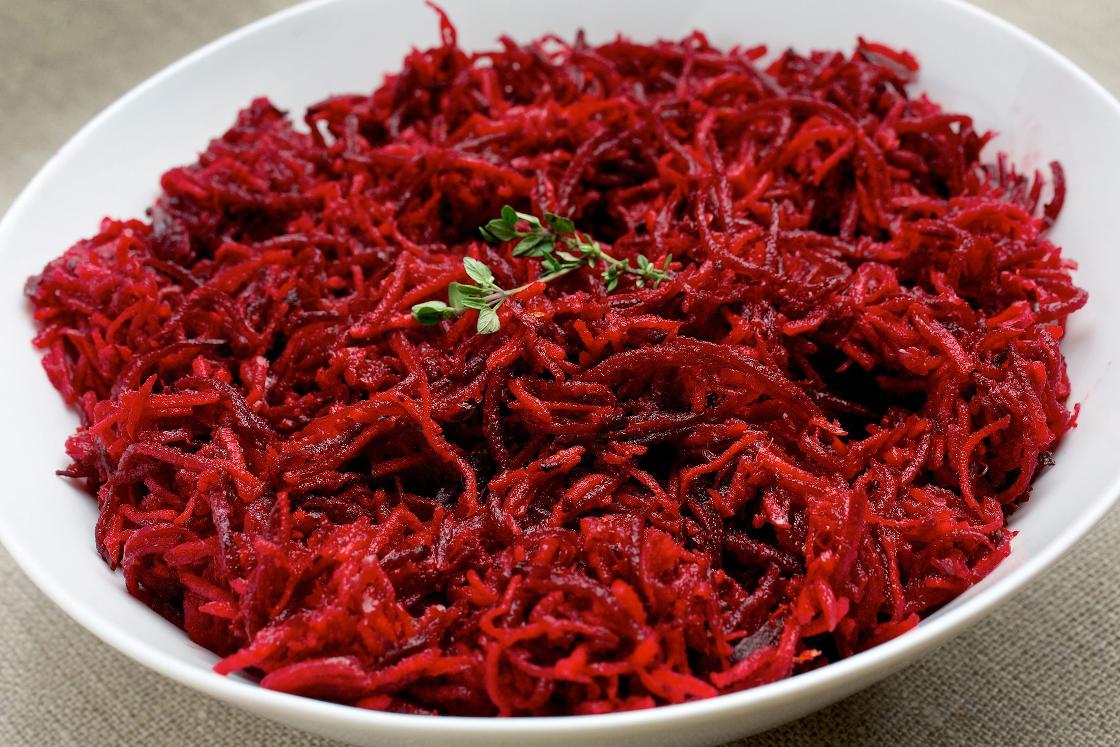 Finely grating the vegetables helps them absorb the juice and spices in this Moroccan-Style Carrot and Beet Salad.
