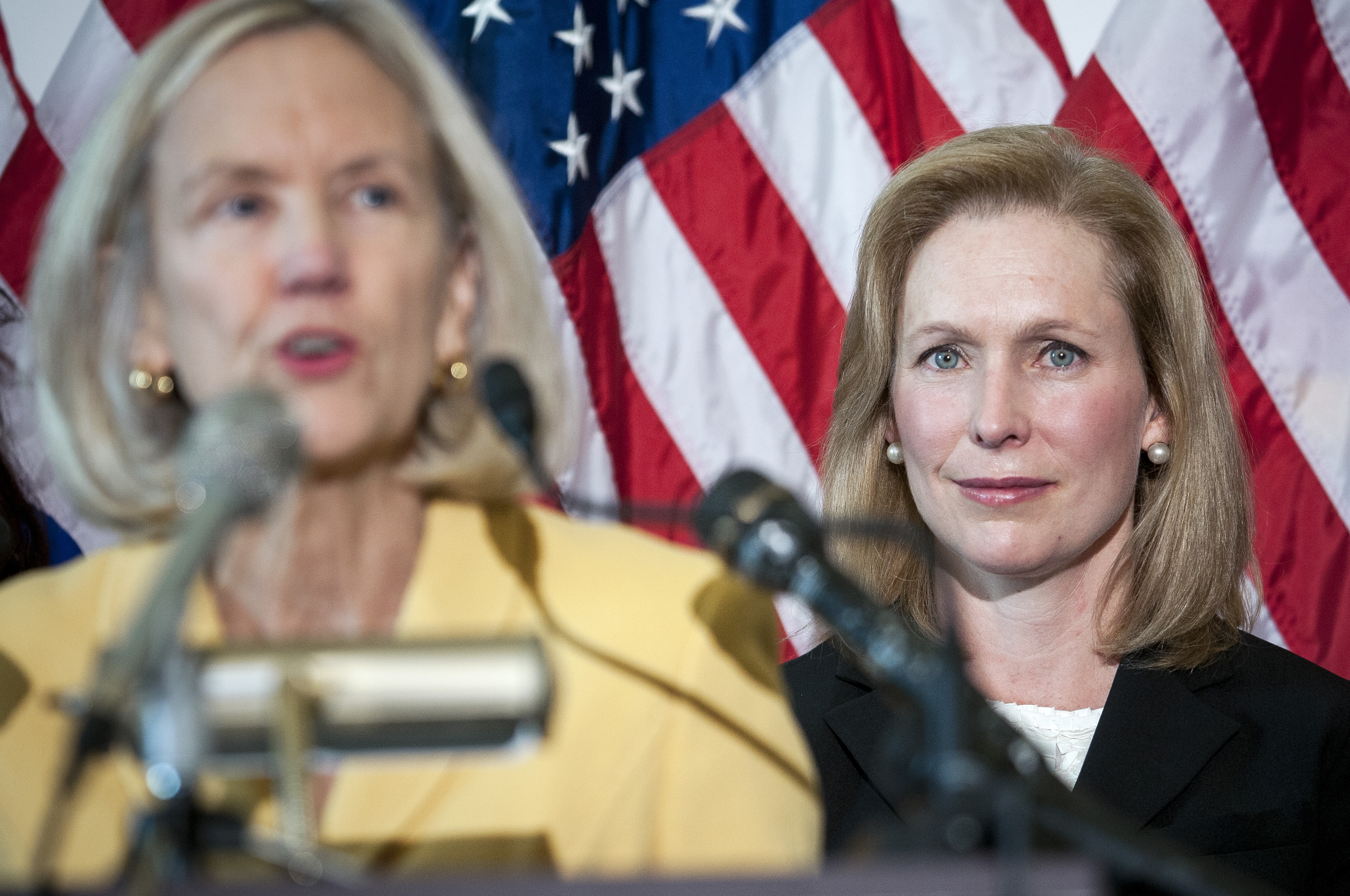 Sen. Kirsten Gillibrand, D-N.Y., right, attends a news conference in Washington earlier this month. Reports of sexual assault in the military increased sharply during the last fiscal year, new Pentagon figures showed Wednesday, just weeks before a defense bill with provisions to tackle the problem is expected to reach the Senate floor.
