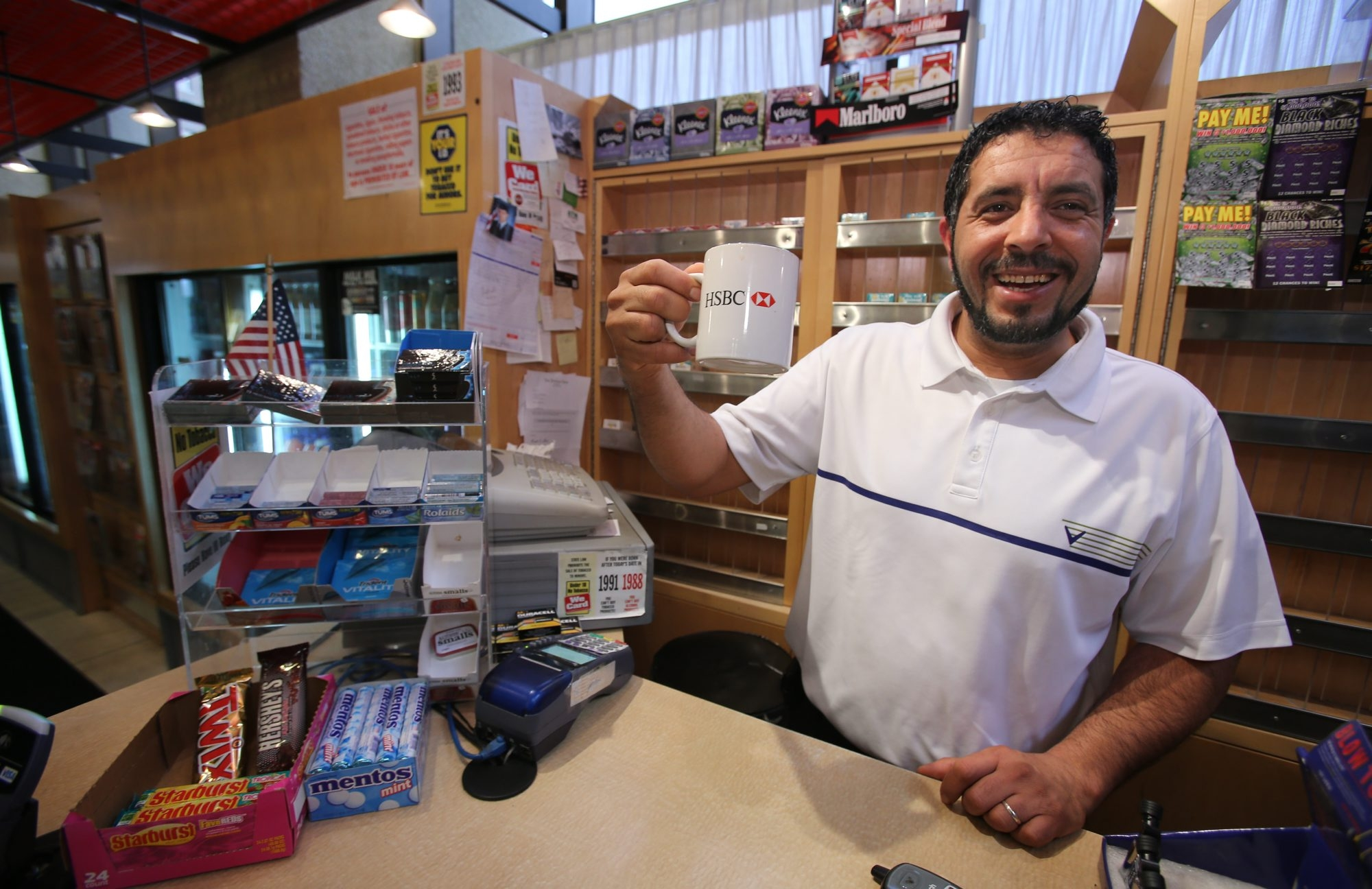 Newsstand owner Ahmed Alhadhari raises a cup Friday to his departed fellow tenants at One Seneca Tower. He expects to be out by year's end.