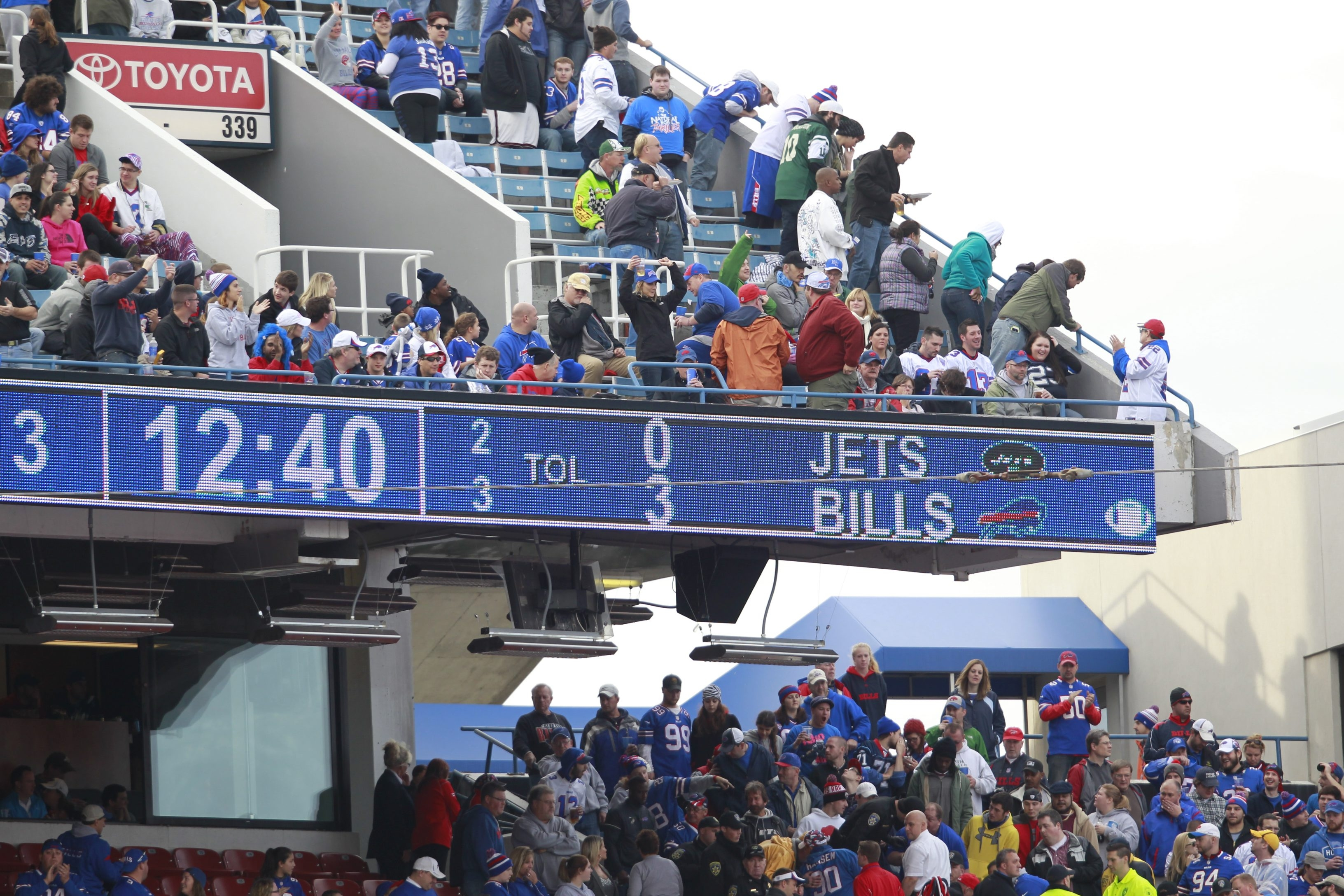 Fourth time this season: Fans watch after Robert Hopkins fell from the upper deck at Ralph Wilson Stadium on Sunday, the fourth such incident at a football game since Aug. 29.
