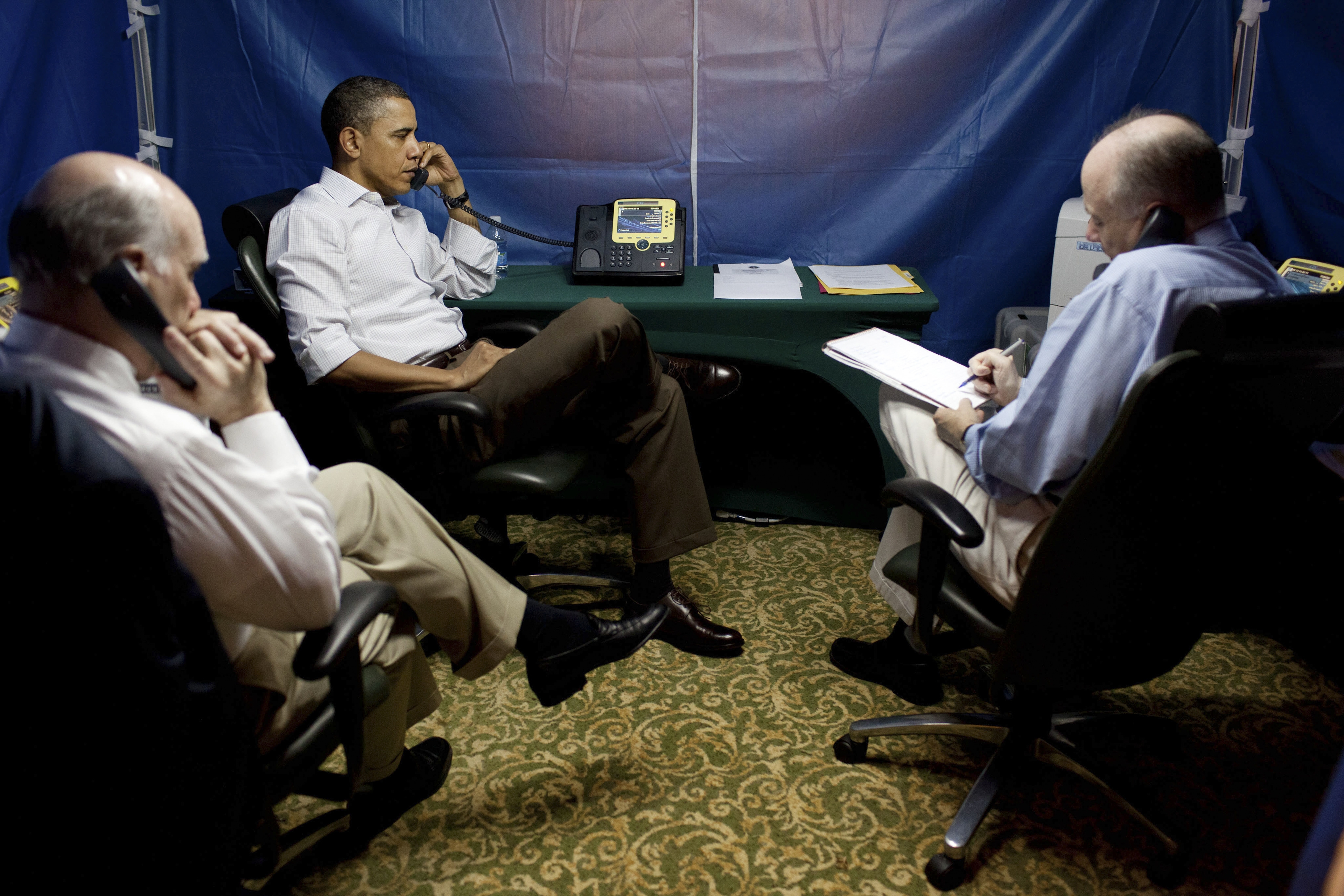 President Obama is briefed on the uprising in Libya during a conference call inside a secure tent set up near his hotel suite in Rio de Janeiro on March 20, 2011.