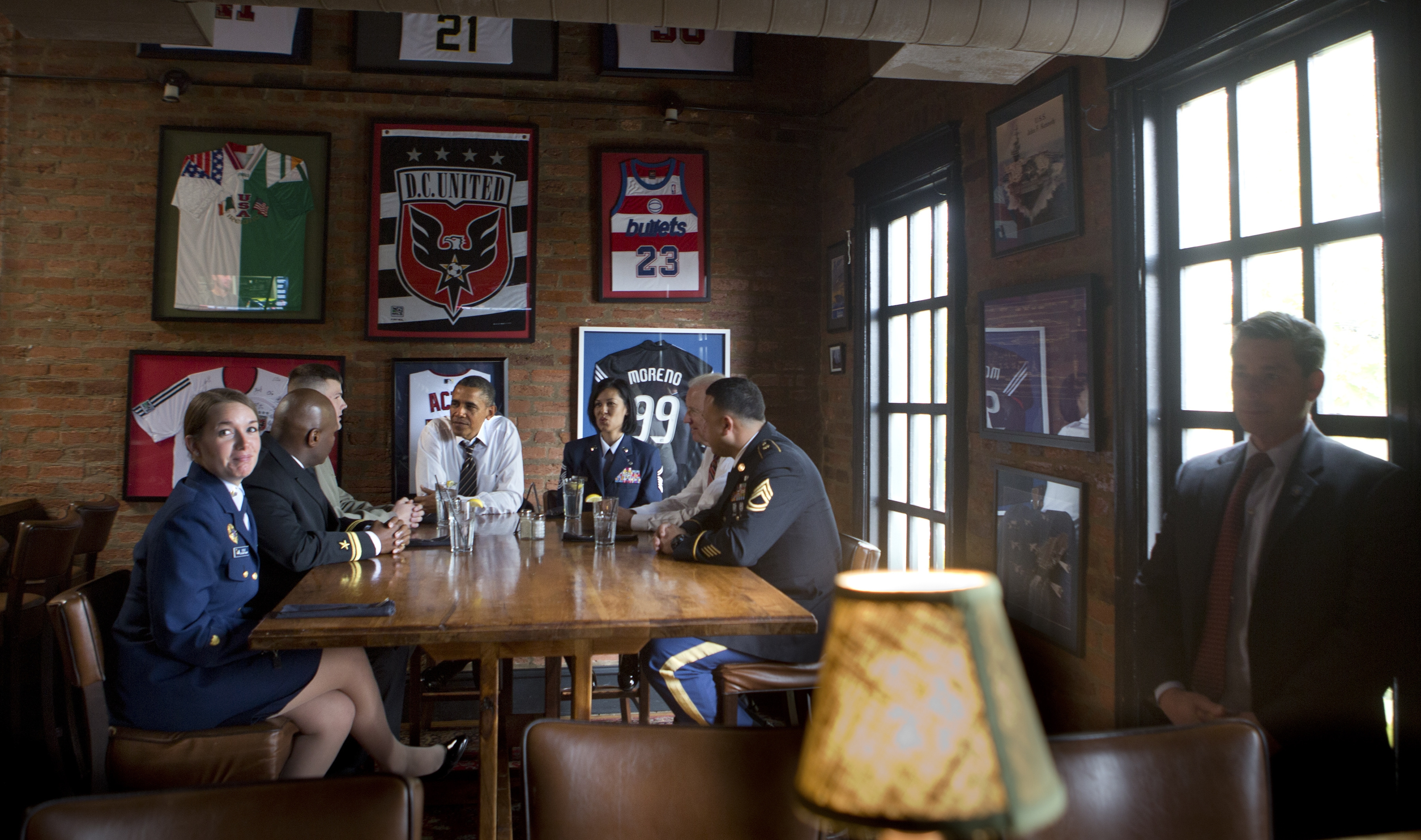 """Coast Guard Petty Officer Katie Cole, 26, far left, a native of Springville, and four other members of the military were invited Monday to dine with President Obama and Vice President Biden at an Irish pub on Capitol Hill on Tuesday. """"Today was just the coolest day of my life,"""" Cole said."""