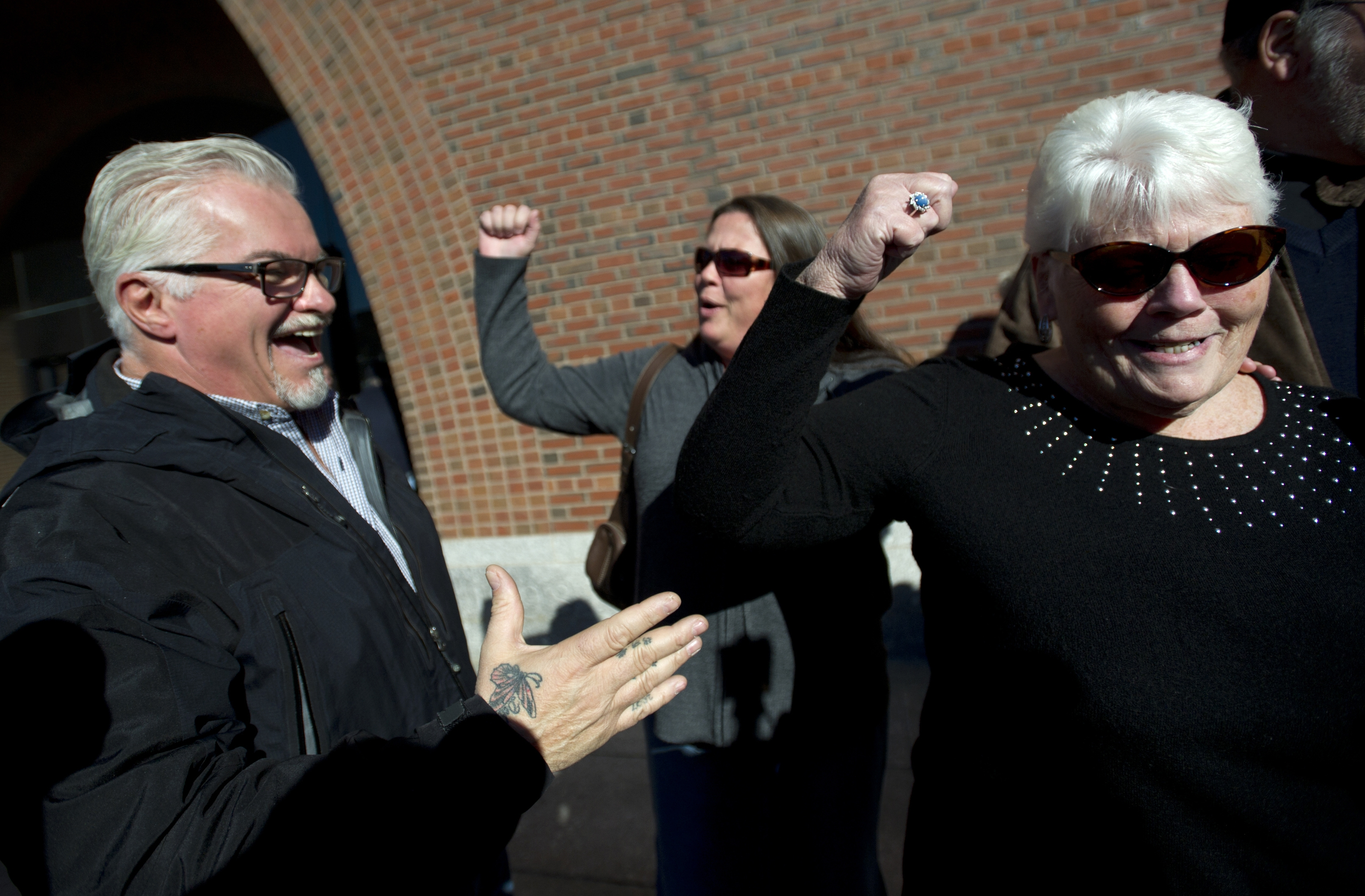 "Murder victims' relatives – from left, Steve Davis, Karen Smith and her mother, Evelyn Connors – celebrate after Boston sentencing of mobster James ""Whitey"" Bulger."