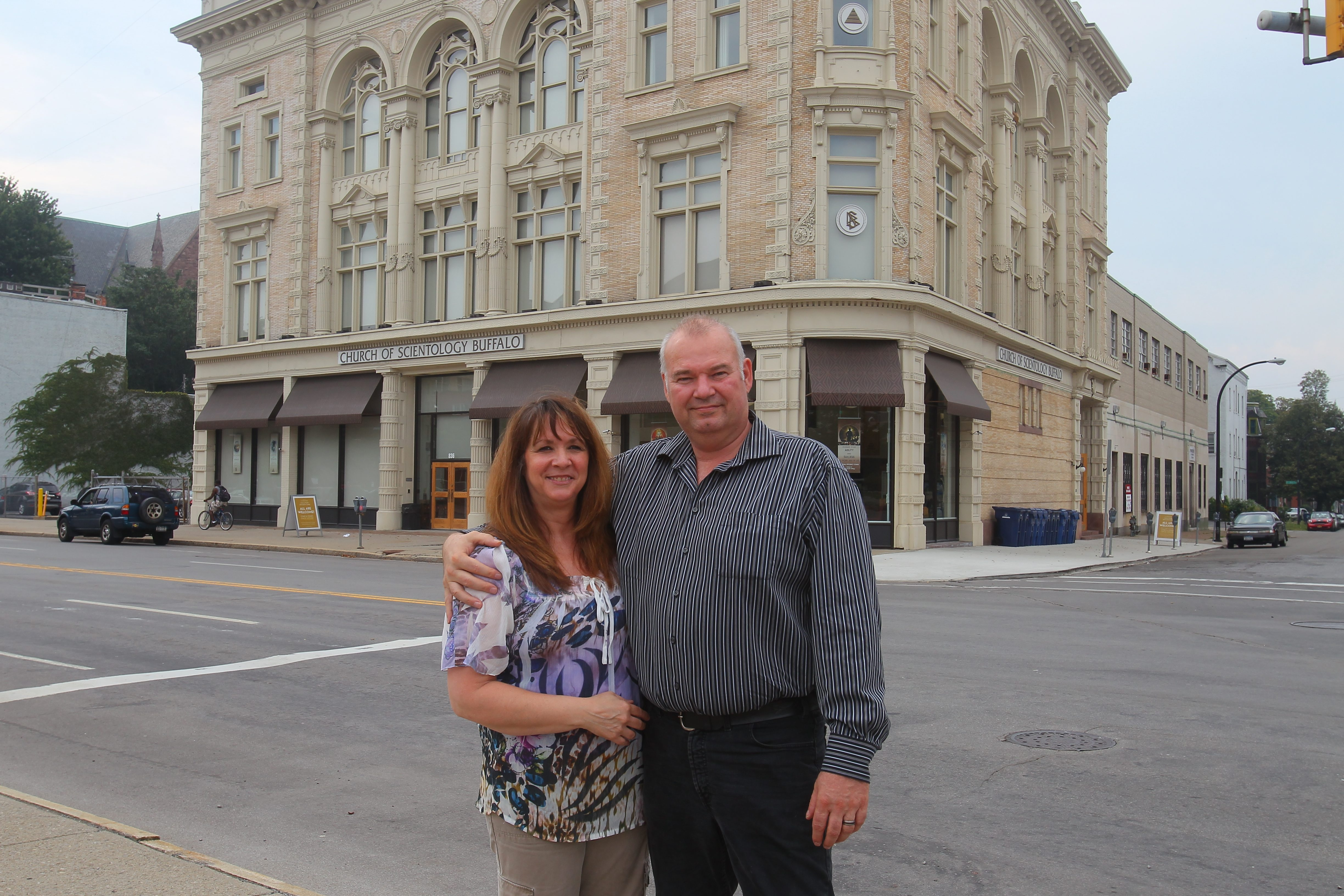 Kim and Michel Brillon, former members of the Church of Scientology who are now on the outs with the church, stand outside the church at Main and Virginia streets in Buffalo on Aug. 27.