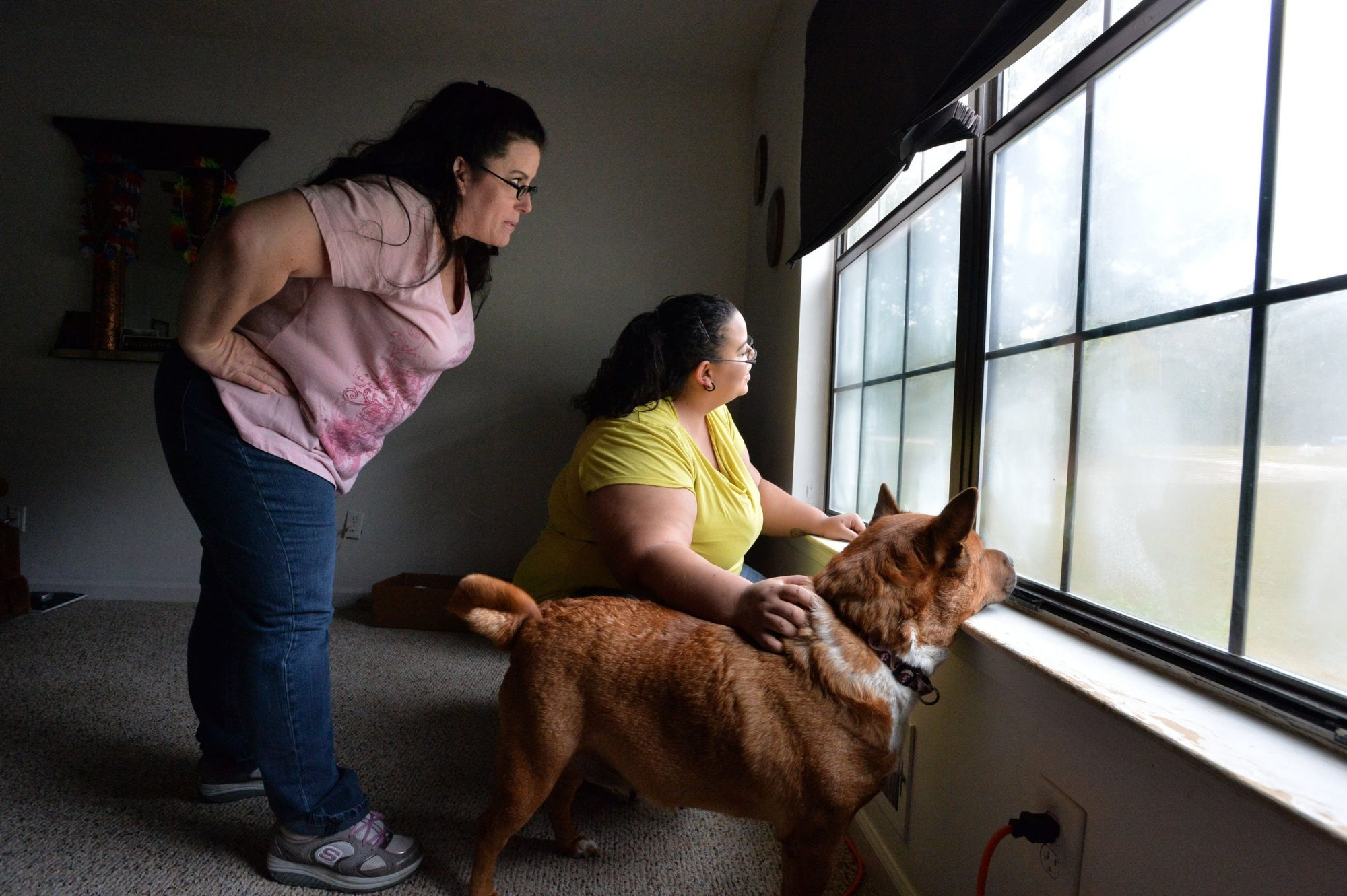 Barbara Hairston, left, pictured at her Tyrone, Ga., home with her daughter, Nichole Corbridge, and dog Tequila, has been unable to find work despite two decades of experience as a medical assistant.