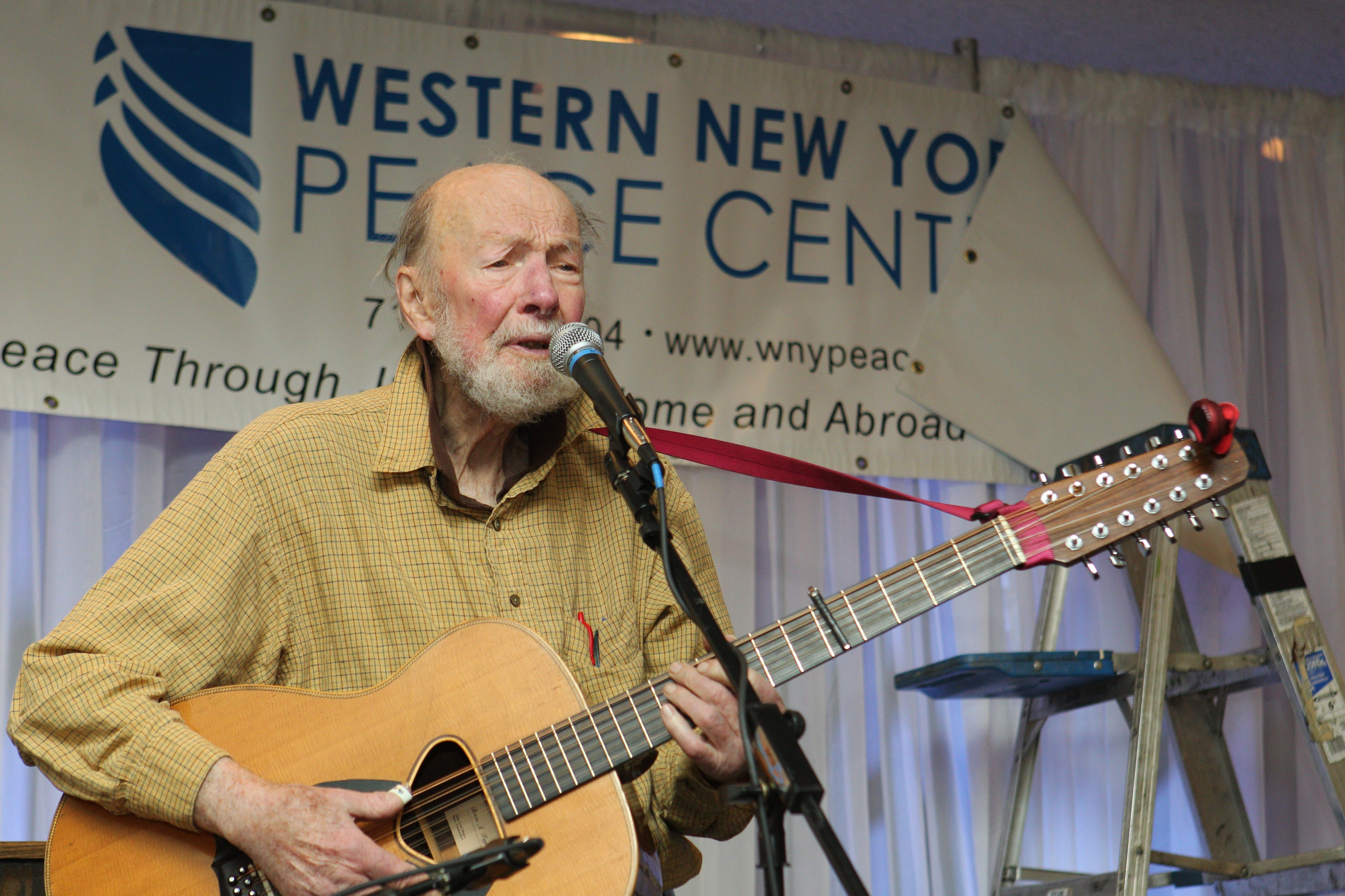 Pete Seeger, still active at 94, performed at the annual fundraising dinner of the Western New York Peace Center at the Buffalo Niagara Convention Center Saturday. He also made stops at the Women in Black vigil and a regional conference of the Newspaper Guild.