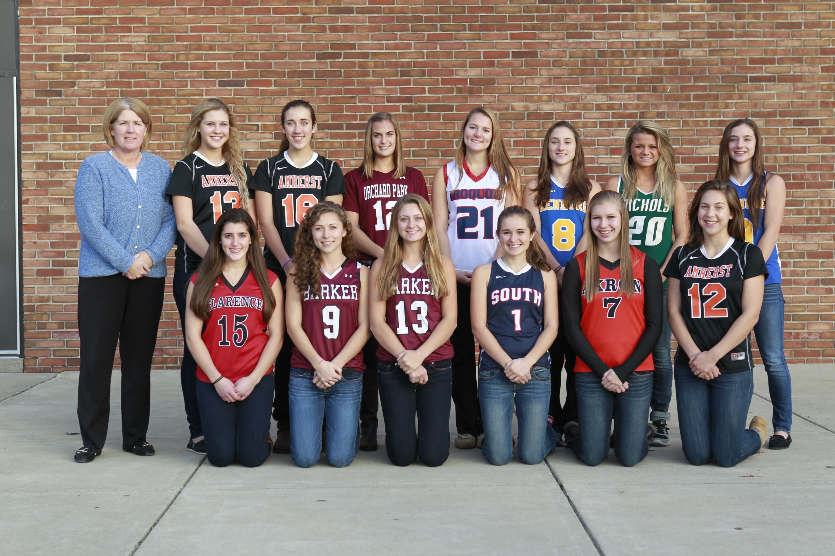 The All-WNY field hockey team, front row, from left: Giovanna Fasanello, Clarence; Olivia Denny, Barker;  Heather Mason, Barker; Morgan Maley, Wmsv. South; Claudia Stone, Akron; and Jane Edginton, Amherst. Back row, from left: ECIC Coach of the Year Laurie LeGoff, Amherst; Taylor Balser, Amherst; Yanna Boggio, Amherst; Emily Markarian, Orchard Park; Kristen Audette, Iroquois; Brianna Mathias, Kenmore; Nicolette Tomani, Nichols, and Kaeli Mathias, Kenmore. Not pictured: Meghan Fonfara, Iroquois.