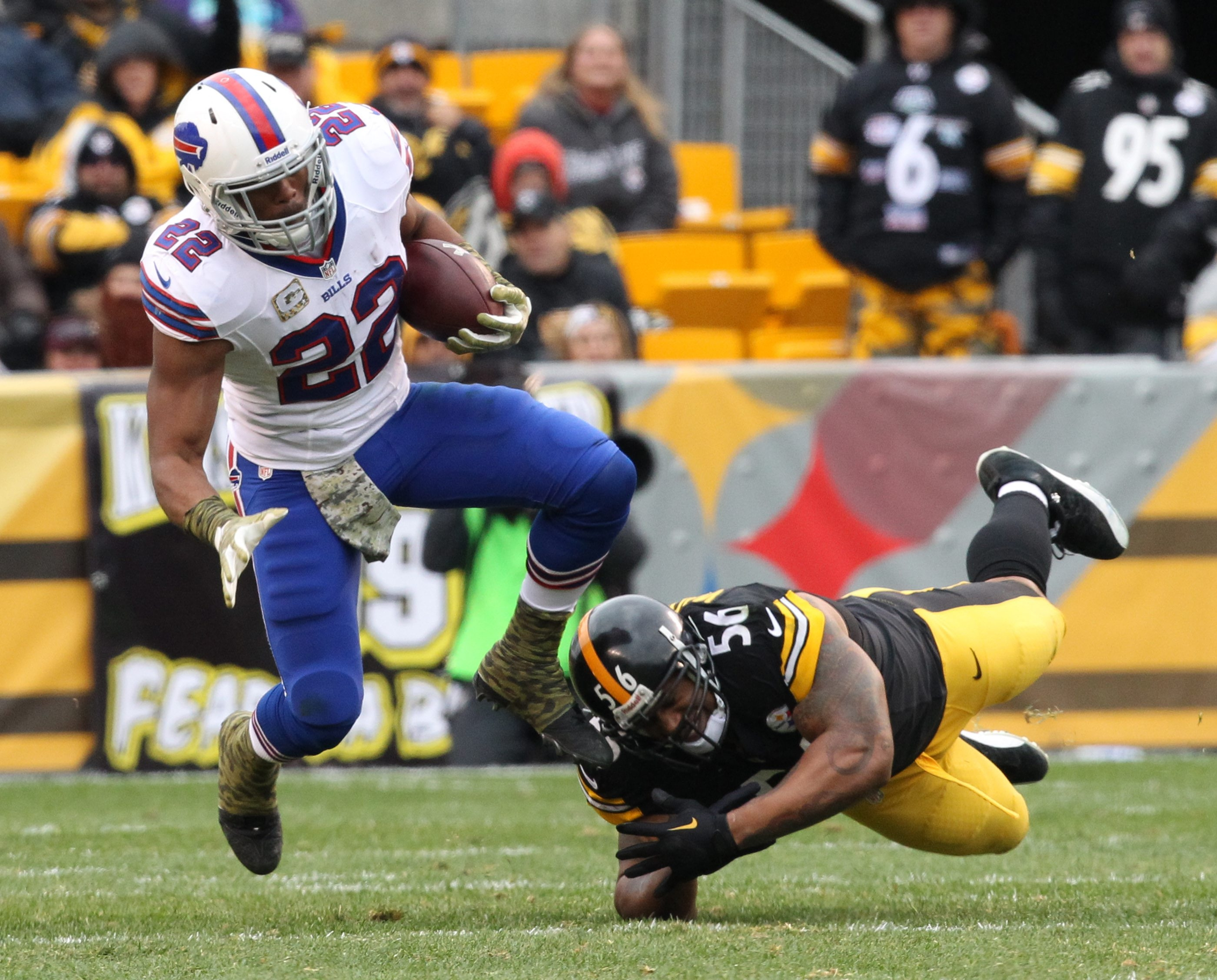 Buffalo Bills running back Fred Jackson (22) is tackled by Pittsburgh Steelers outside linebacker LaMarr Woodley (56) in the first quarter at Heinz Field on Sunday, Nov. 10, 2013.  {Photo by James P. McCoy / Buffalo News}