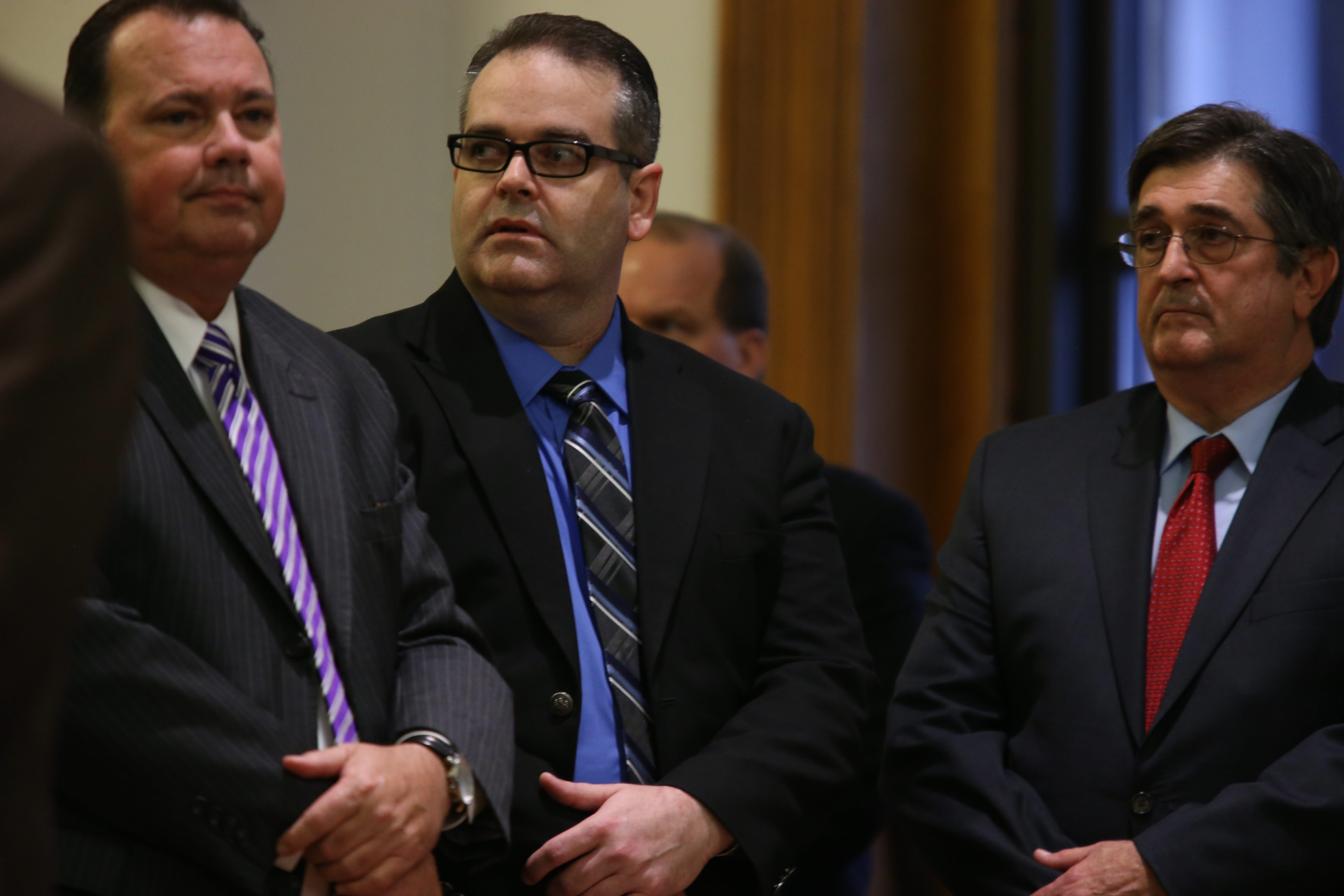 Anthony Taglianetti, center, listens to the jury read the verdict at the Chautauqua County Courthouse in Mayville on Friday.
