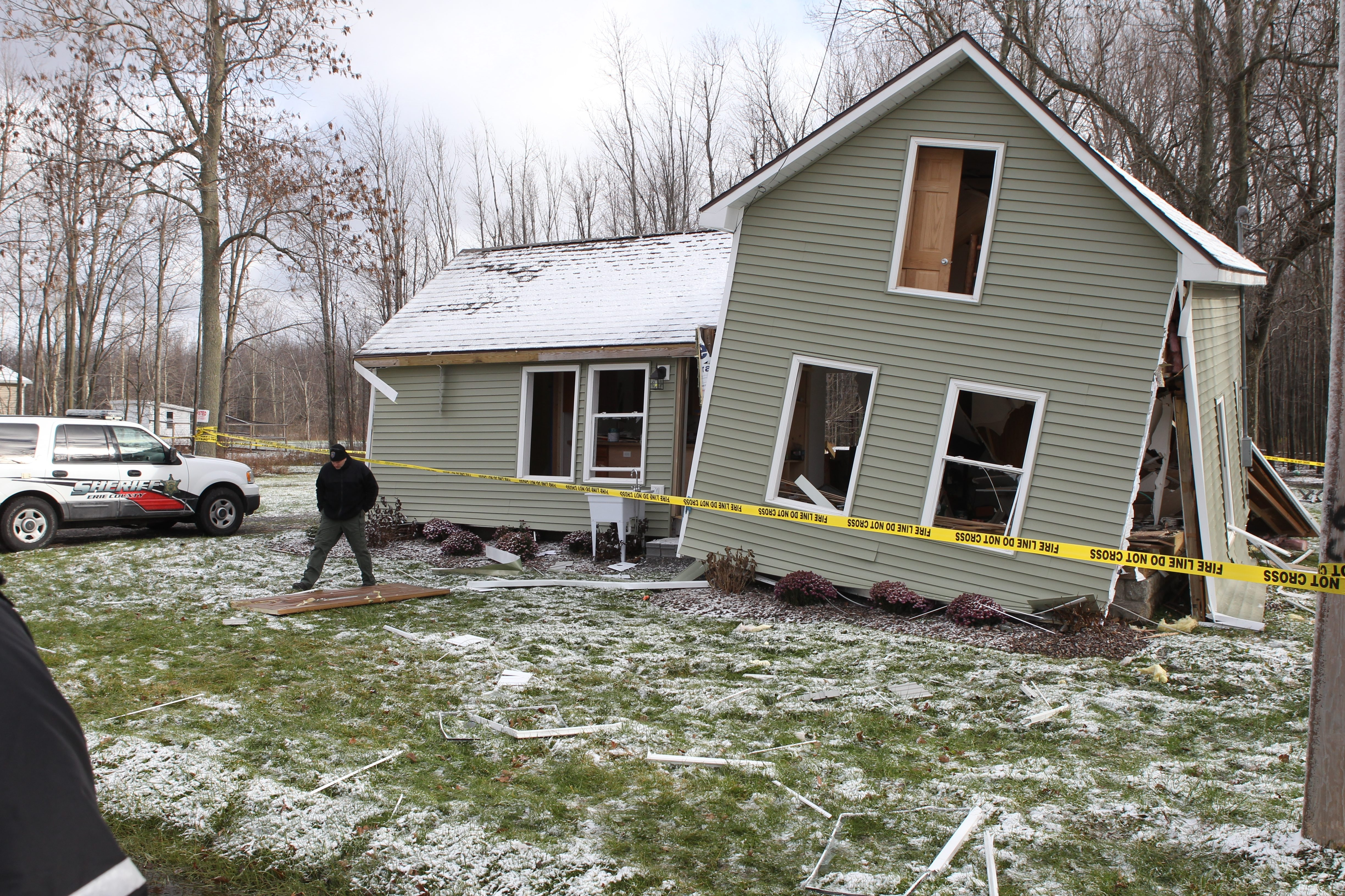 Erie County sheriff's deputy investigates an explosion that knocked a Newstead home off its foundation. See a video at BuffaloNews.com..