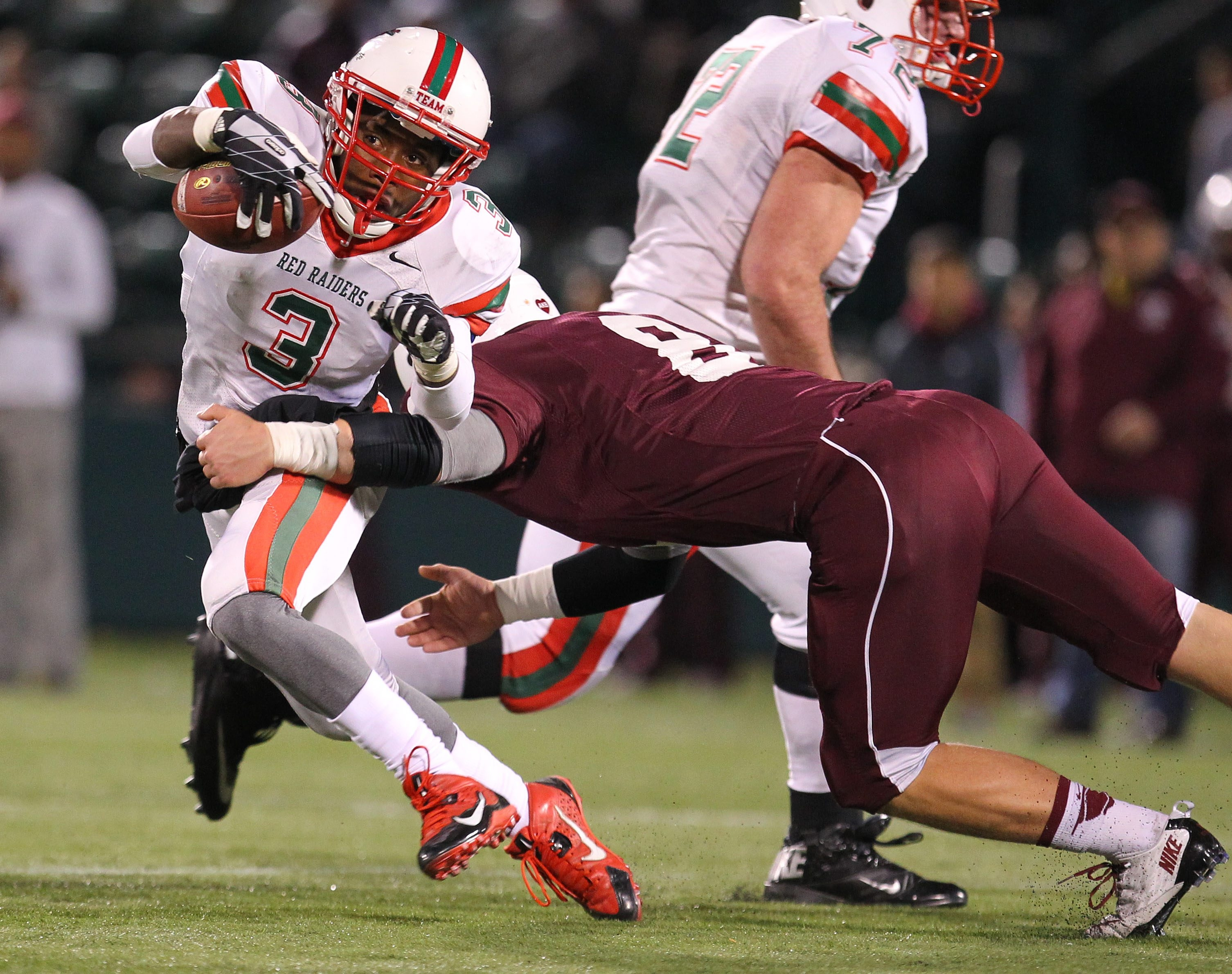 Jamestown's Zacc Kinsey tries to get past Aquinas' Charlie Rist.