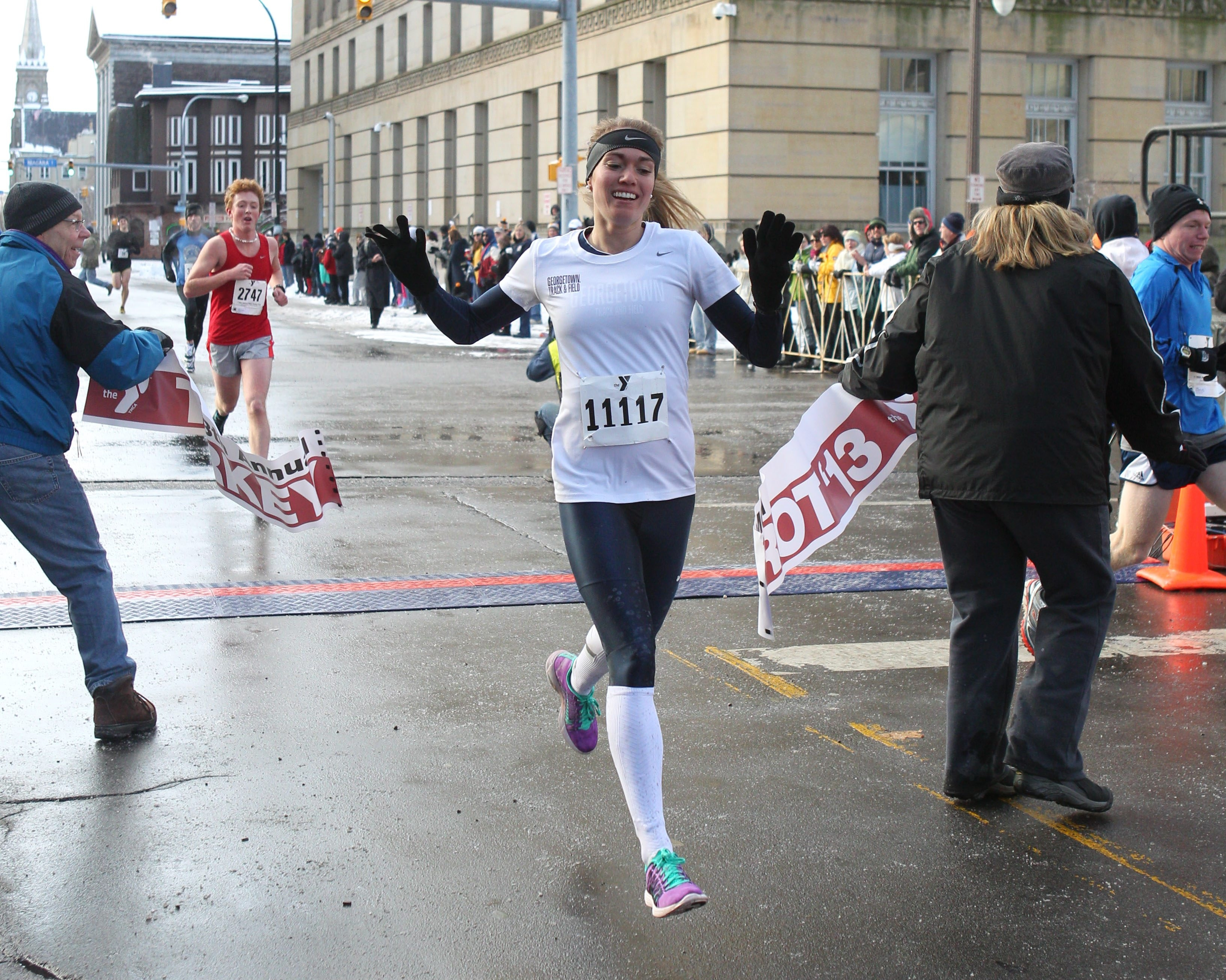 Jake Krolick, left, and Rachel Schneider were the top finishers in the Turkey Trot this year.