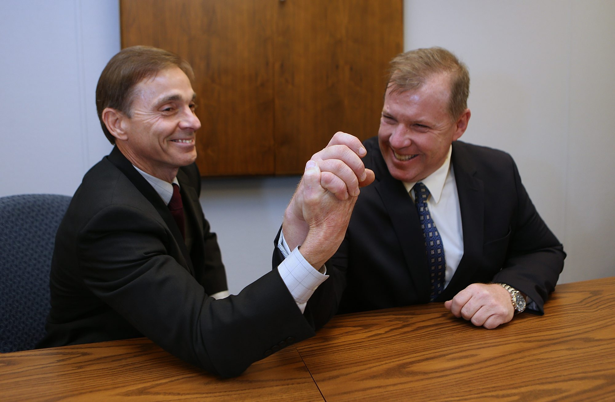 Roger J. Klatt, left, superintendent of Barker and Royalton-Hartland schools, and Michael S. Wendt, superintendent of Wilson and Newfane schools,  meet and compete in a conference room at the Barker Central administrative offices.