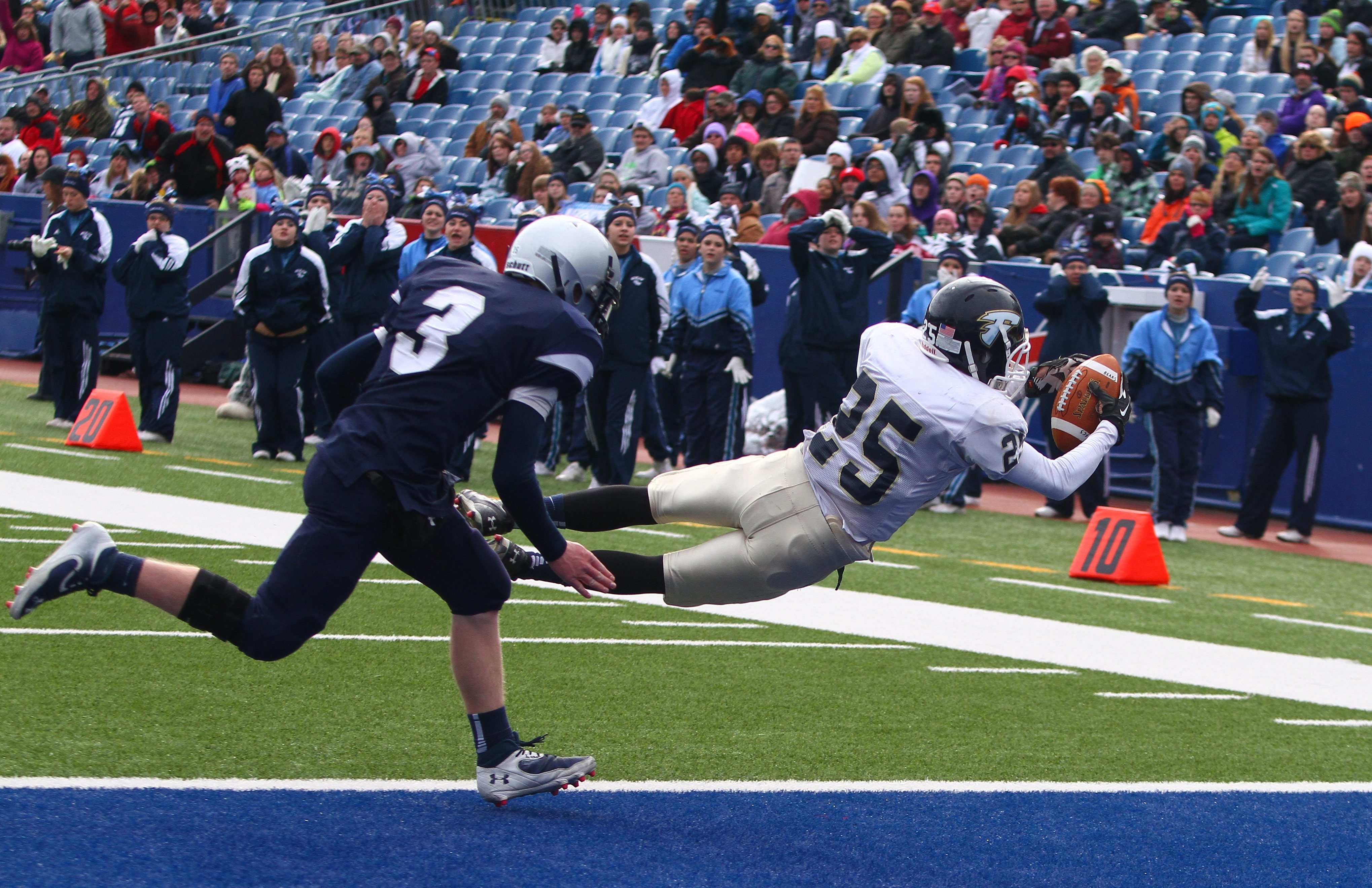 Frewsburg's Jordan Ingerson (25) dives in for a touchdown ahead of Cattaraugus/Little Valley's Kyle O'Donnell (3).