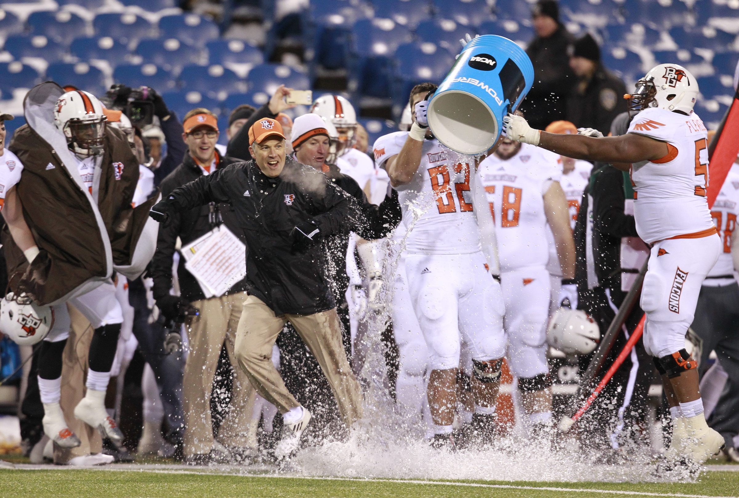 Bowling Green coach and Lewiston-Porter grad Dave Clawson gets the water bucket treatment after the Falcons' 24-7 victory Friday.