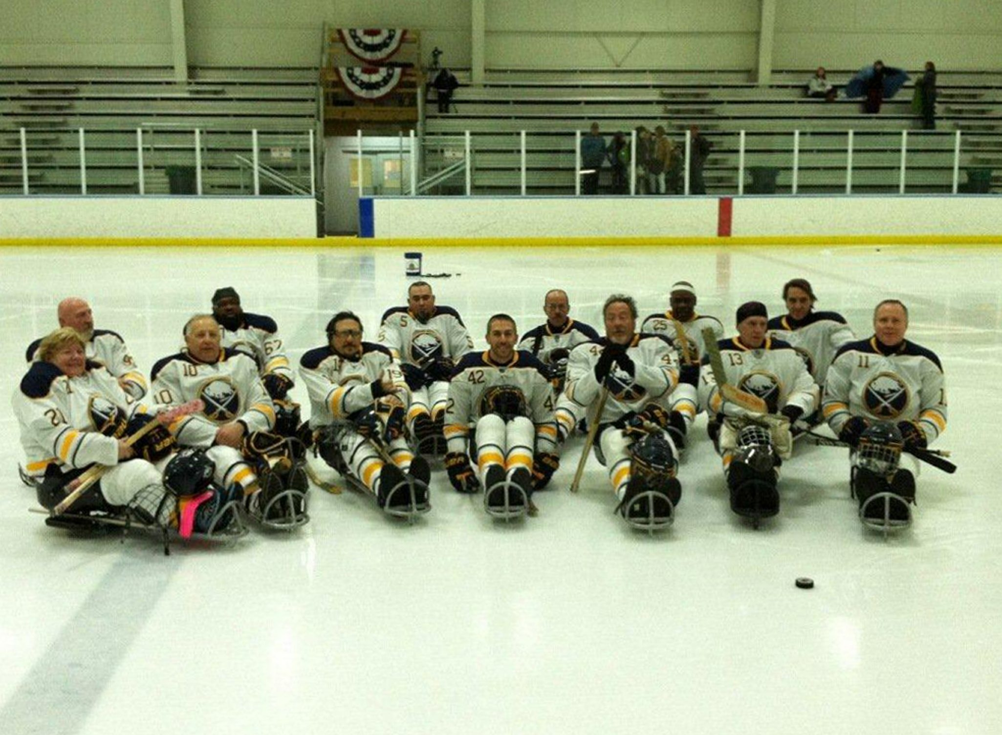 The Buffalo Sled Vets gather for a team photo at a recent practice in the Northtown Center in Amherst.