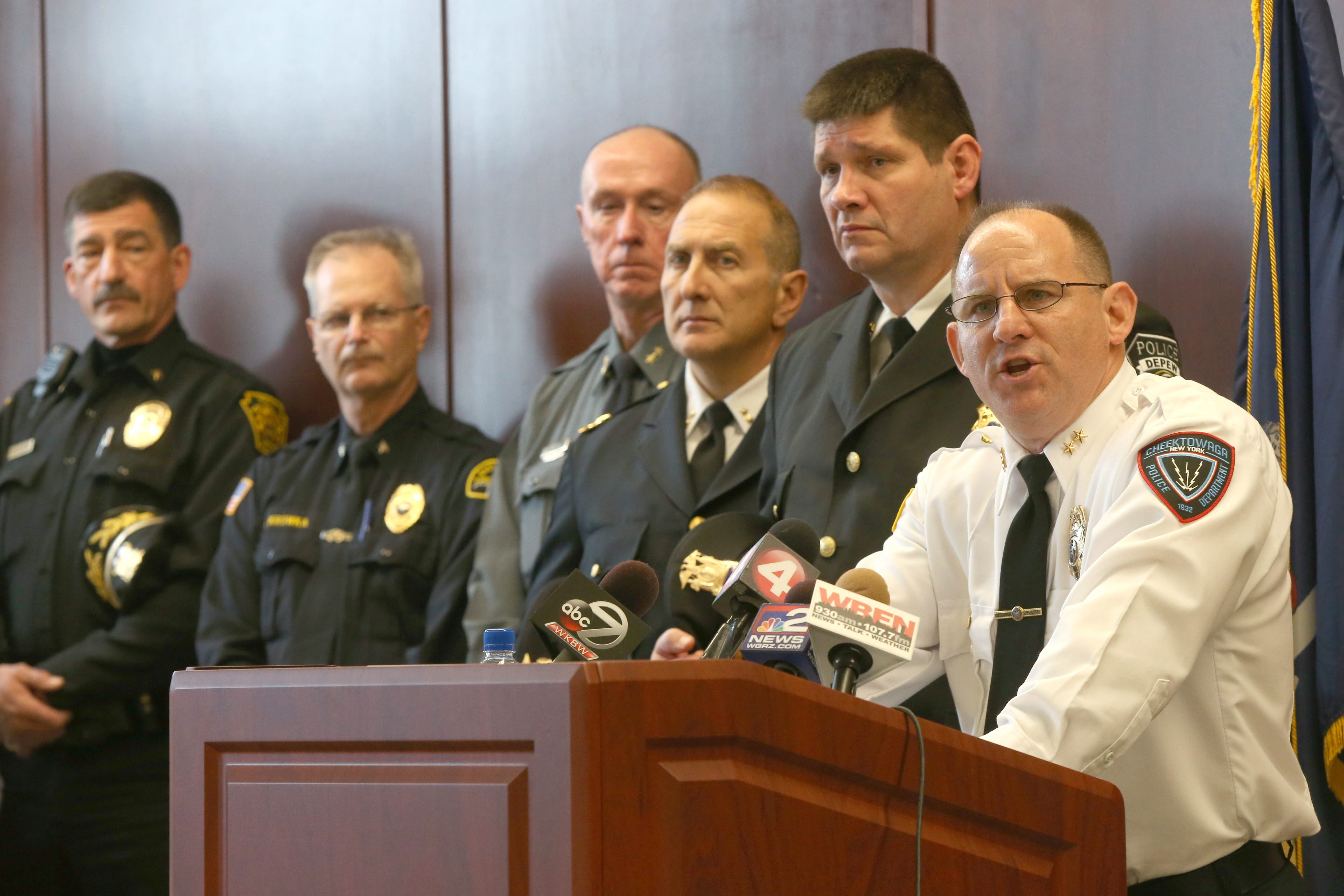 An outraged Cheektowaga Police Chief David Zack called a news conference to release tapes of  conversations teachers had with Dontre Jones. Zack was joined by other chiefs of police and members of law enforcement.  (Robert Kirkham/Buffalo News)