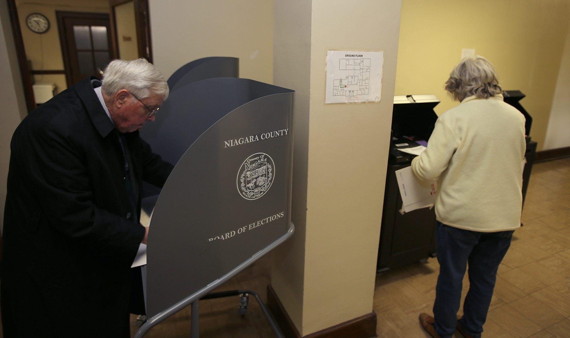 James Perry fills out his ballot at North Tonawanda City Hall, Tuesday, November 5, 2013.
