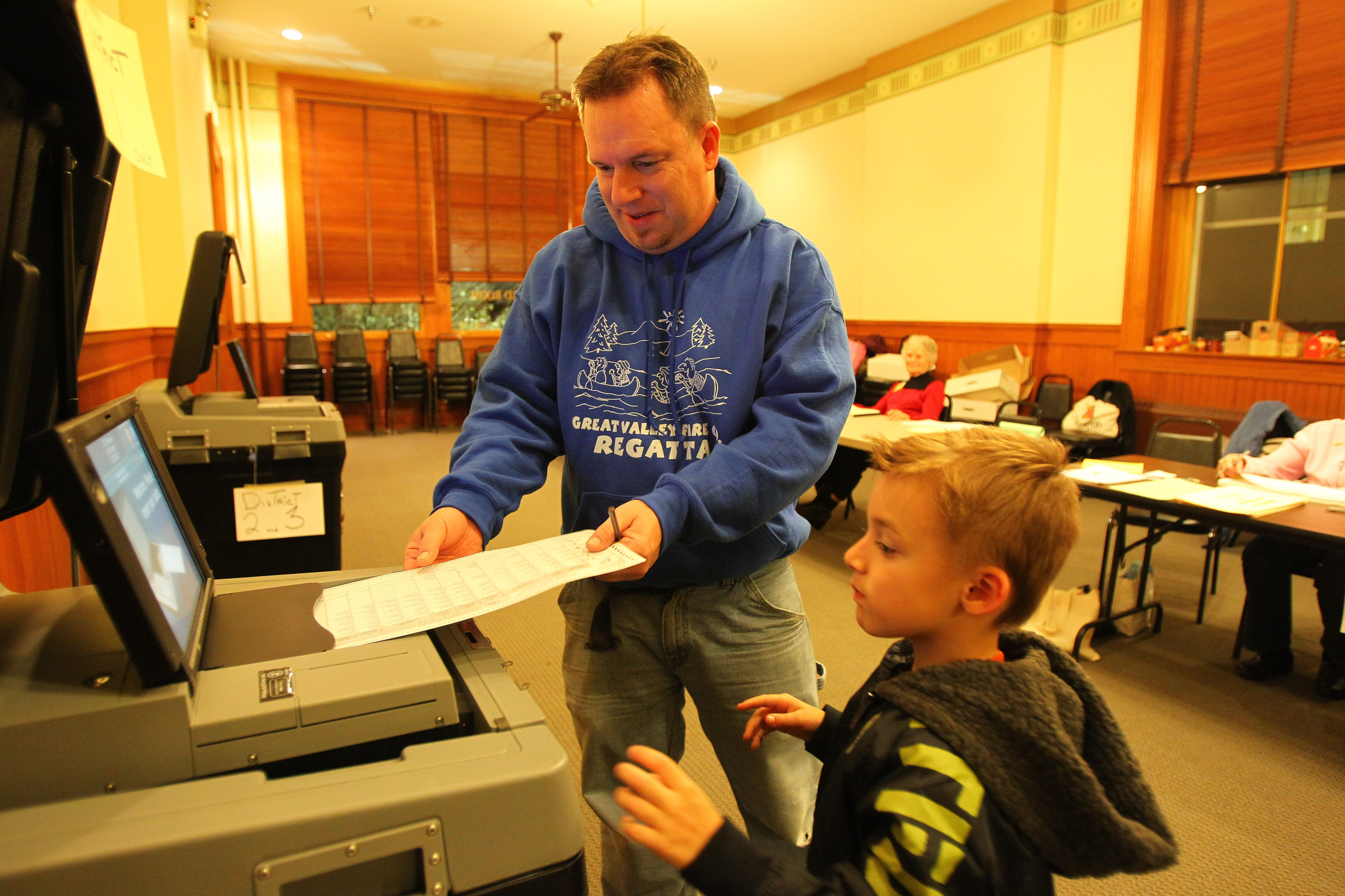 """Mike Sprada and his son Ryan vote at the Lancaster Municipal Building on Tuesday. The town's GOP leaders thought they had a """"comeback team"""" to regain control of the board, but Democratic incumbents retained their seats, giving the party a 4-1 majority."""