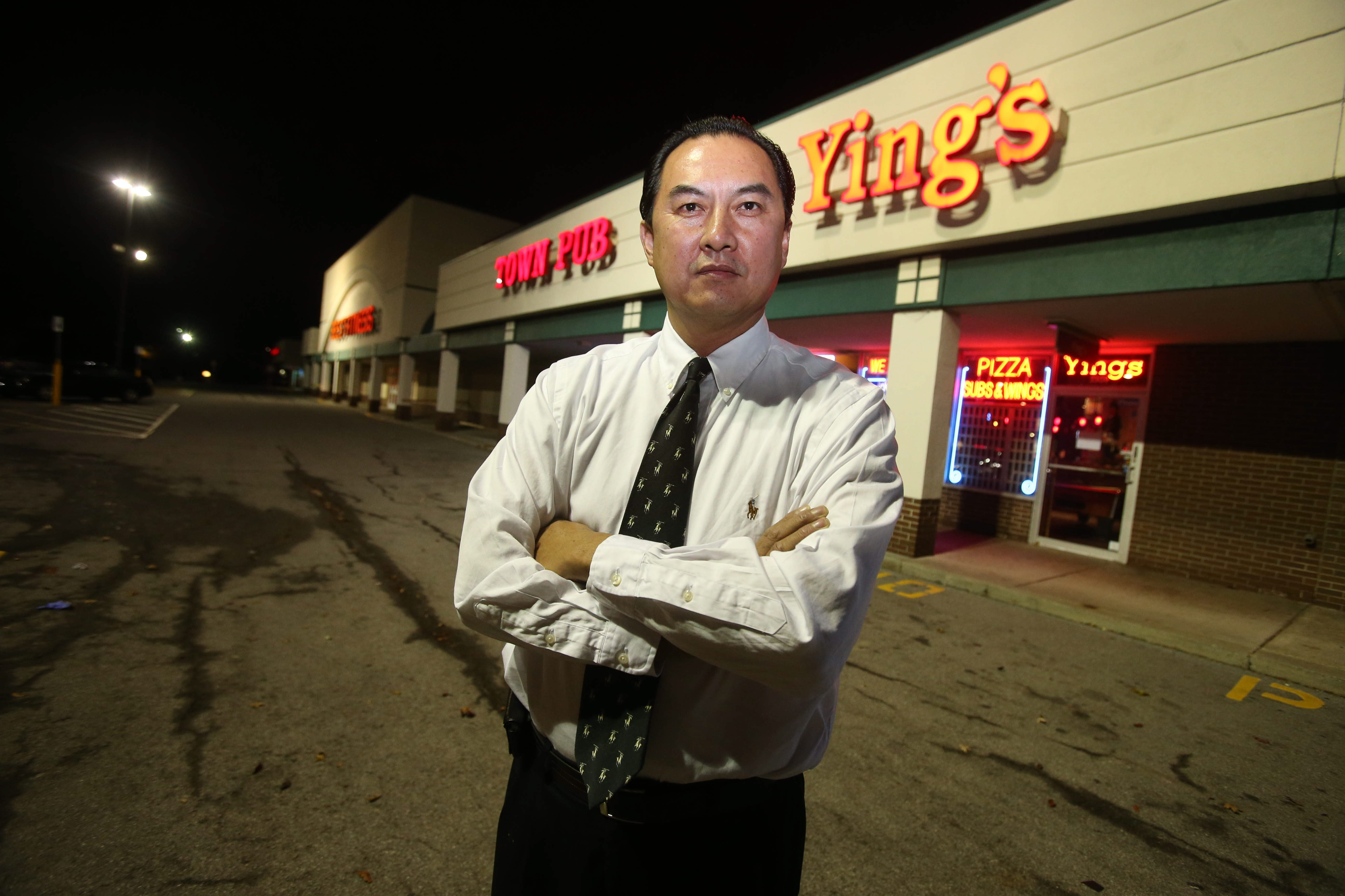 Jimmy Ying, owner of a restaurant at Sheridan Drive and Eggert Road where there was a non-alcohol DJ party, was taken into custody briefly on nuisance charge after gunfire in parking lot.