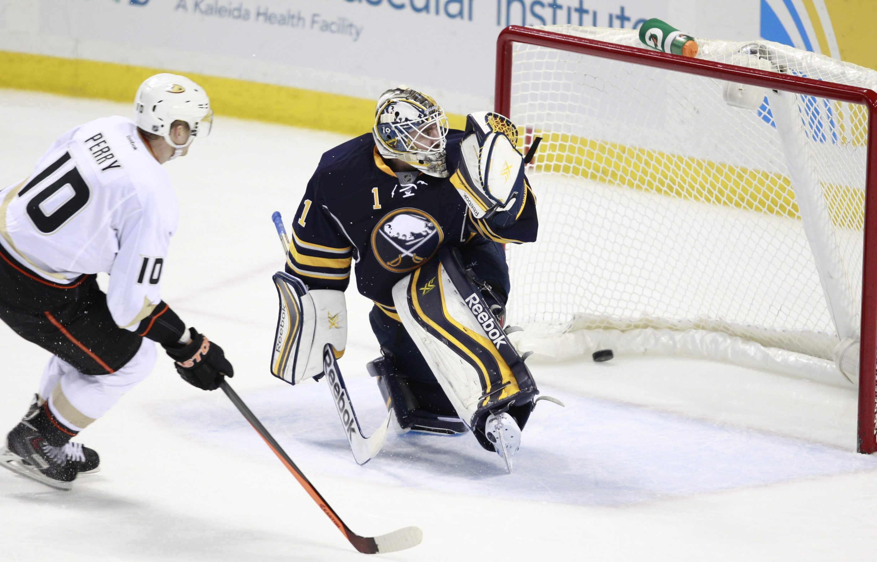 Sabres goaltender Jhonas Enroth can't stop a shot by Corey Perry of the Ducks during the third period Saturday.