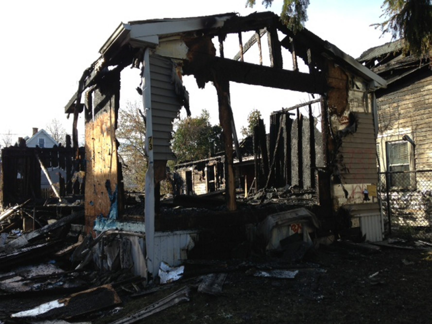 A fire early today gutted this vacant house at 737 North Division St. and heavily damaged homes on either side.