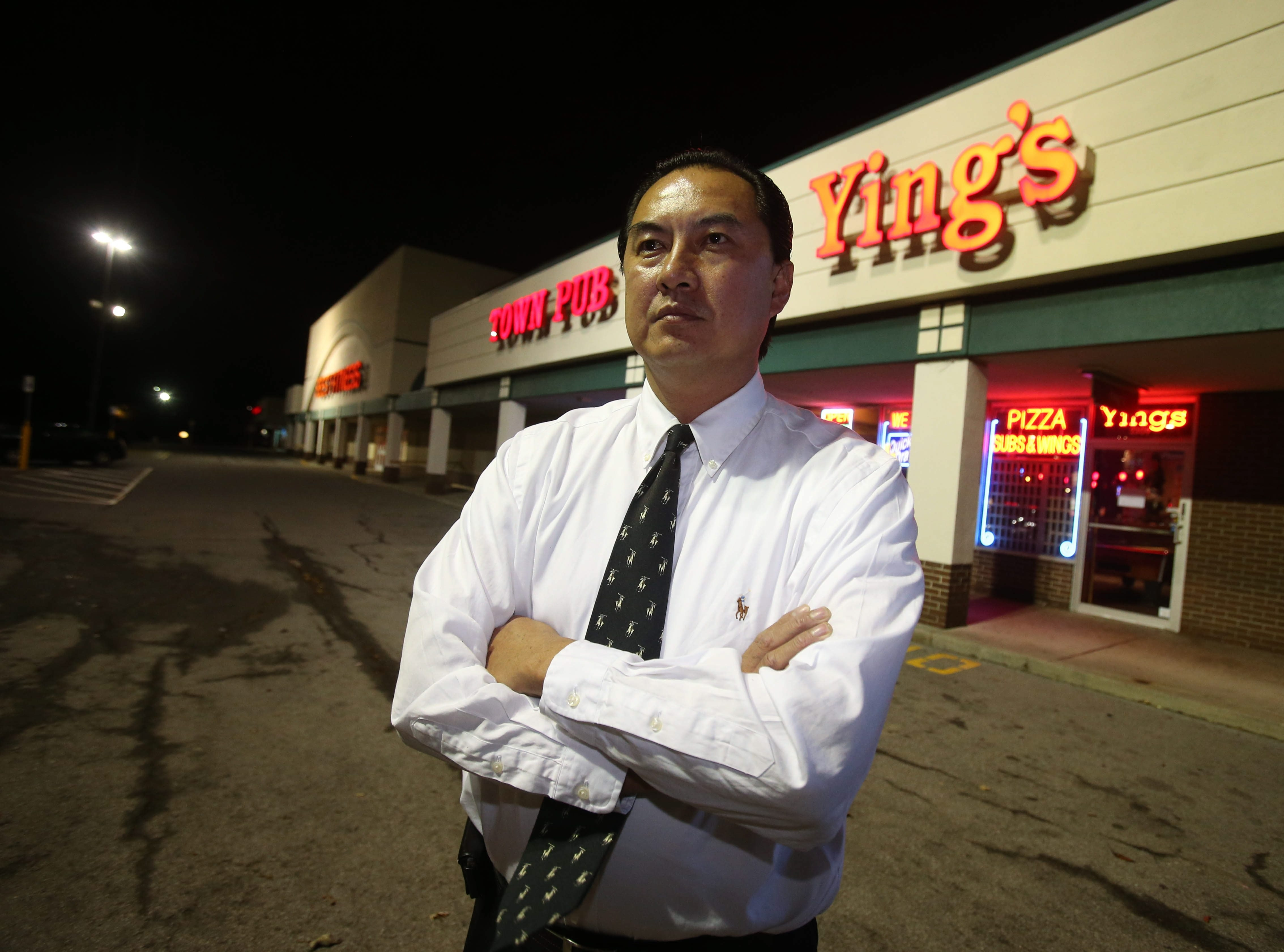 Jimmy Ying, owner of Ying's Wings and Things, accuses Town of Tonawanda police of harassment and racial prejudice.