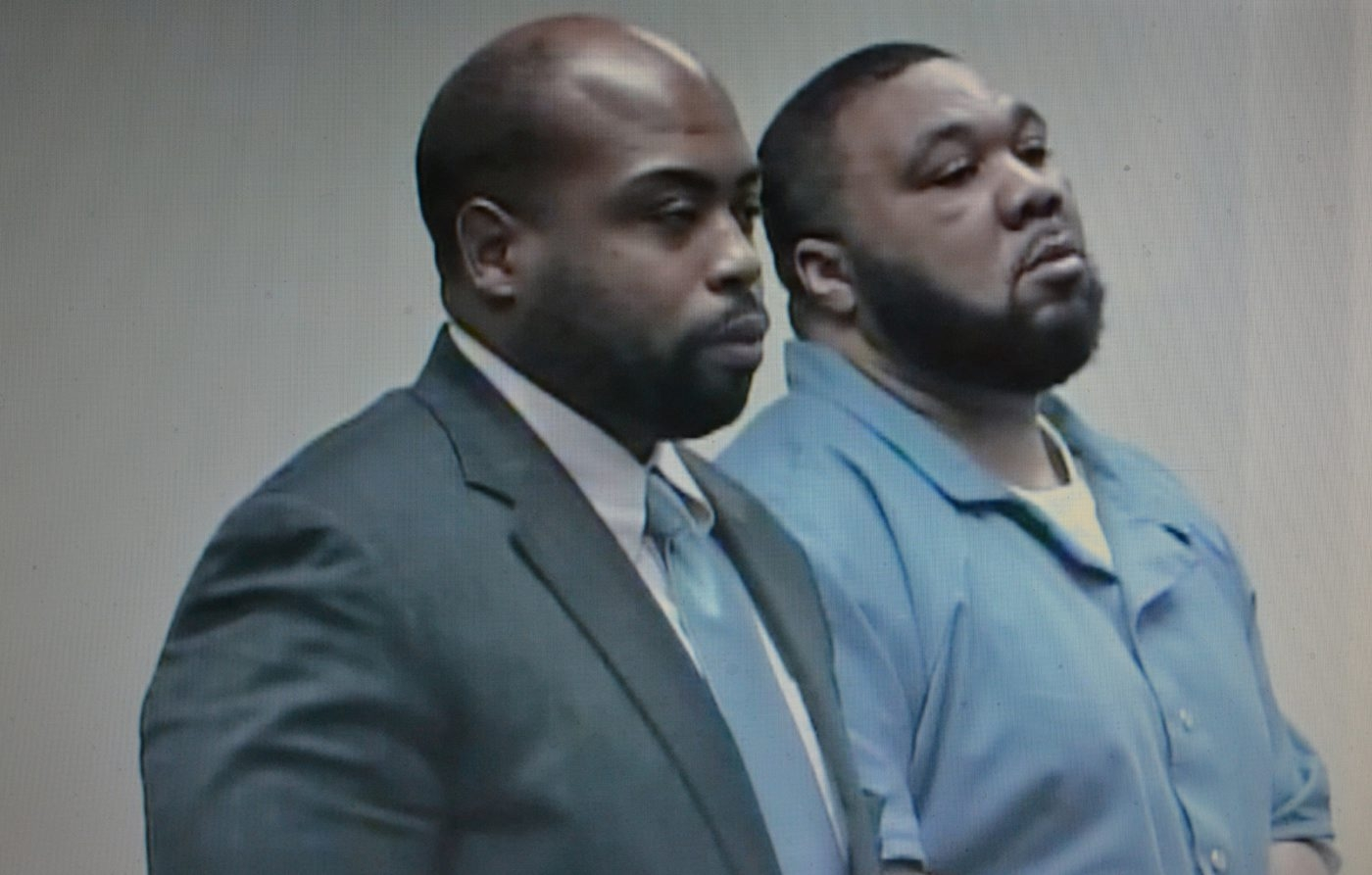 Willie R. Scott Jr., right, and his attorney E. Earl Key await the judge's announcement of Scott's sentence on Monday.