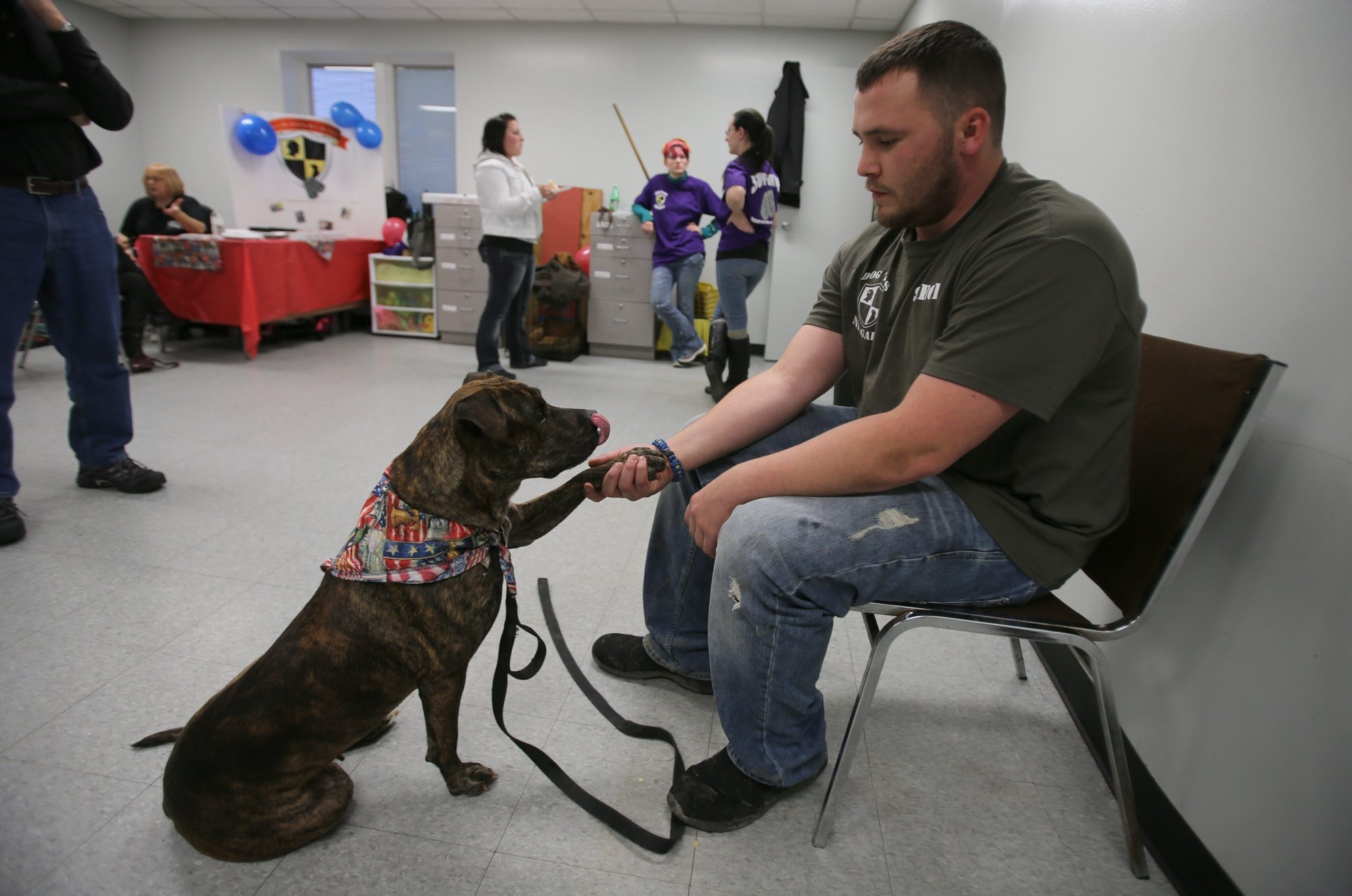 Sergio Cardenas of Lewiston interacts with his dog Zera, at the Niagara County SPCA in Niagara Falls, Monday, November 11, 2013.  Cardenas served with the U.S. Army from 2006 to 2008.  (Charles Lewis/Buffalo News)