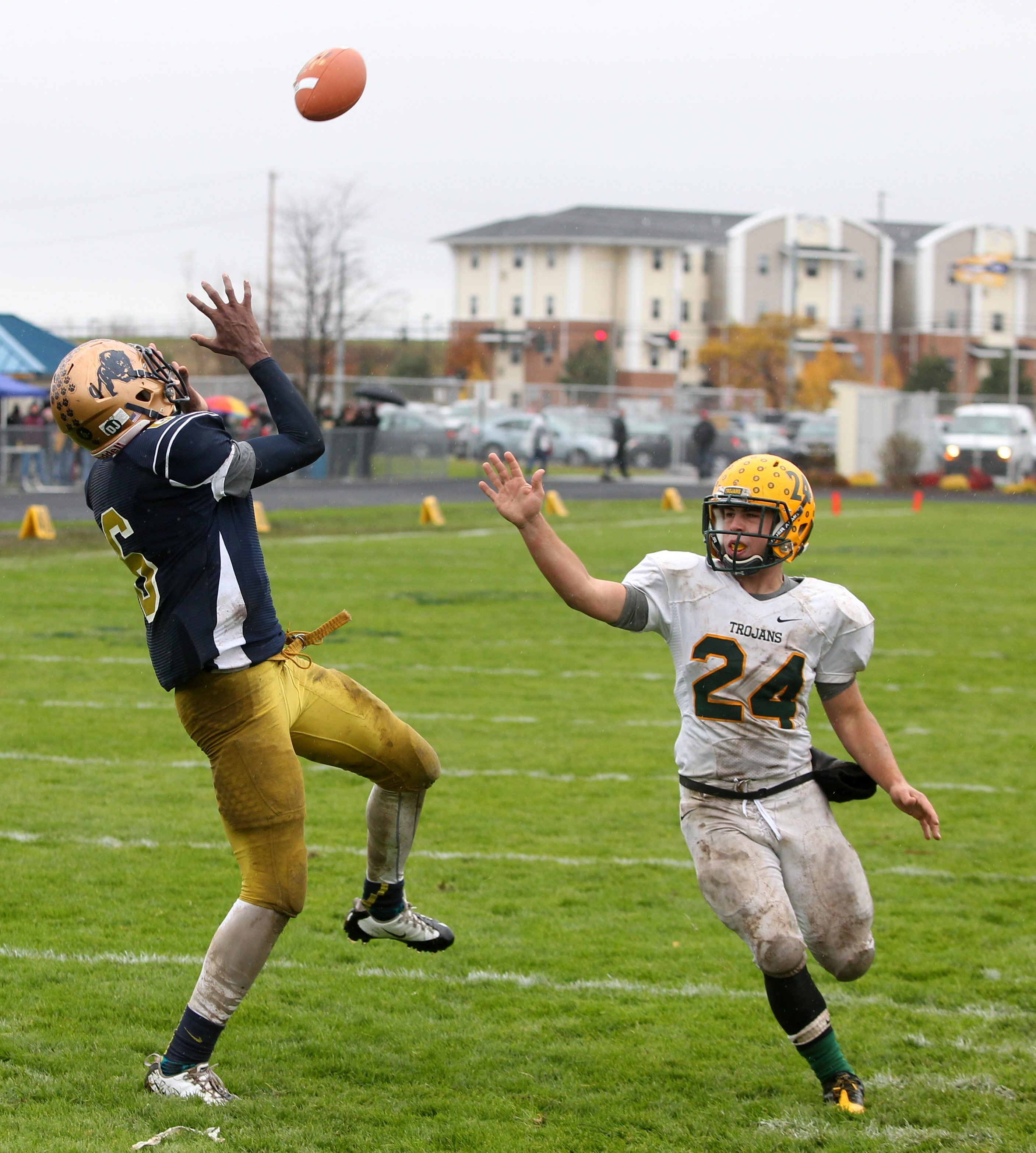Sweet Home's Brandon Smiley makes a touchdown reception as West Seneca East's Mike Waterman (24) defends.