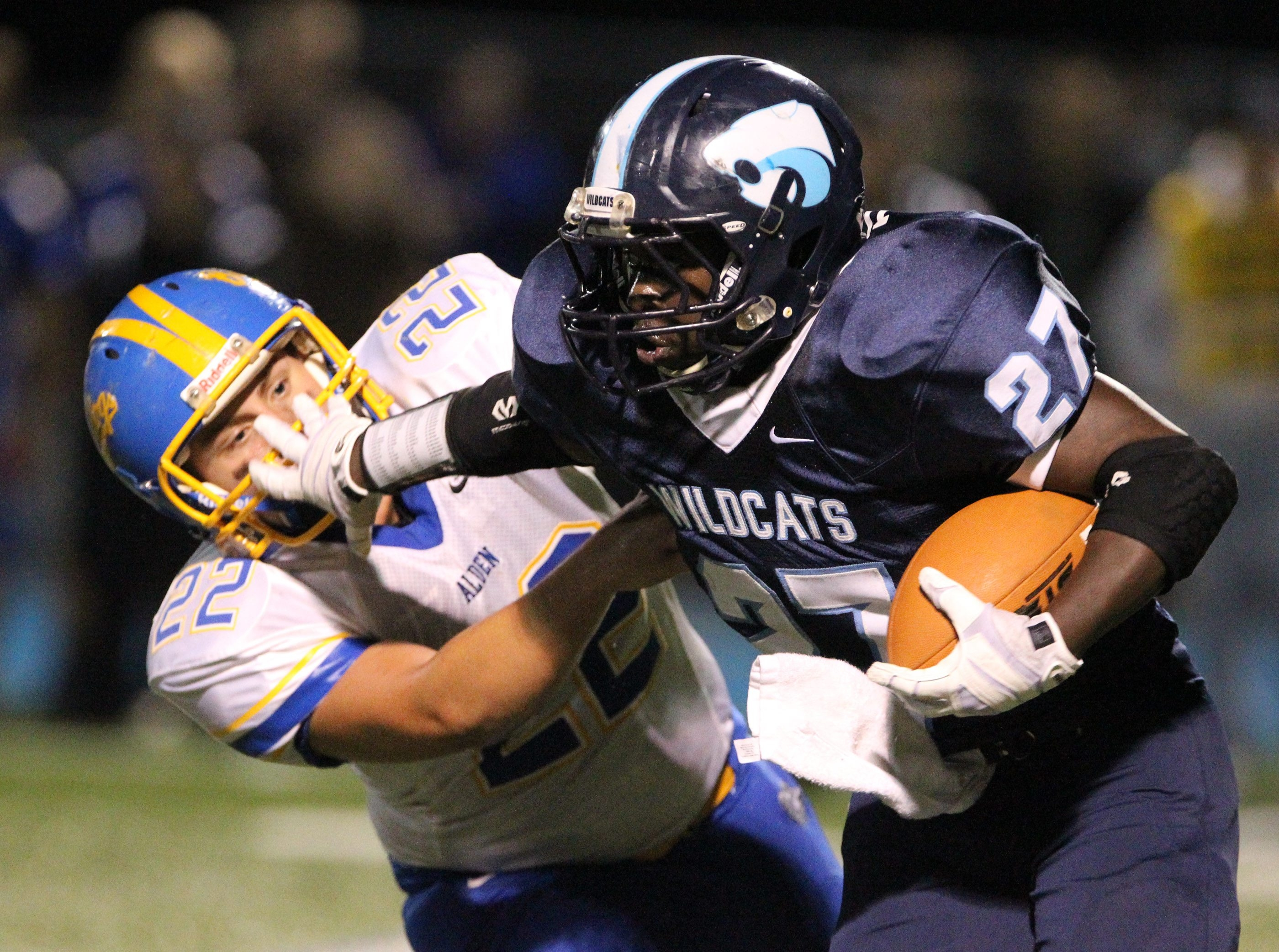 Depew's Rodney Turner rushes  past Alden's AJ Patterson for a first down against Alden's in the first quarter at Depew High School in Depew,NY on Friday, Sept. 27, 2013.  {James P. McCoy/ Buffalo News}