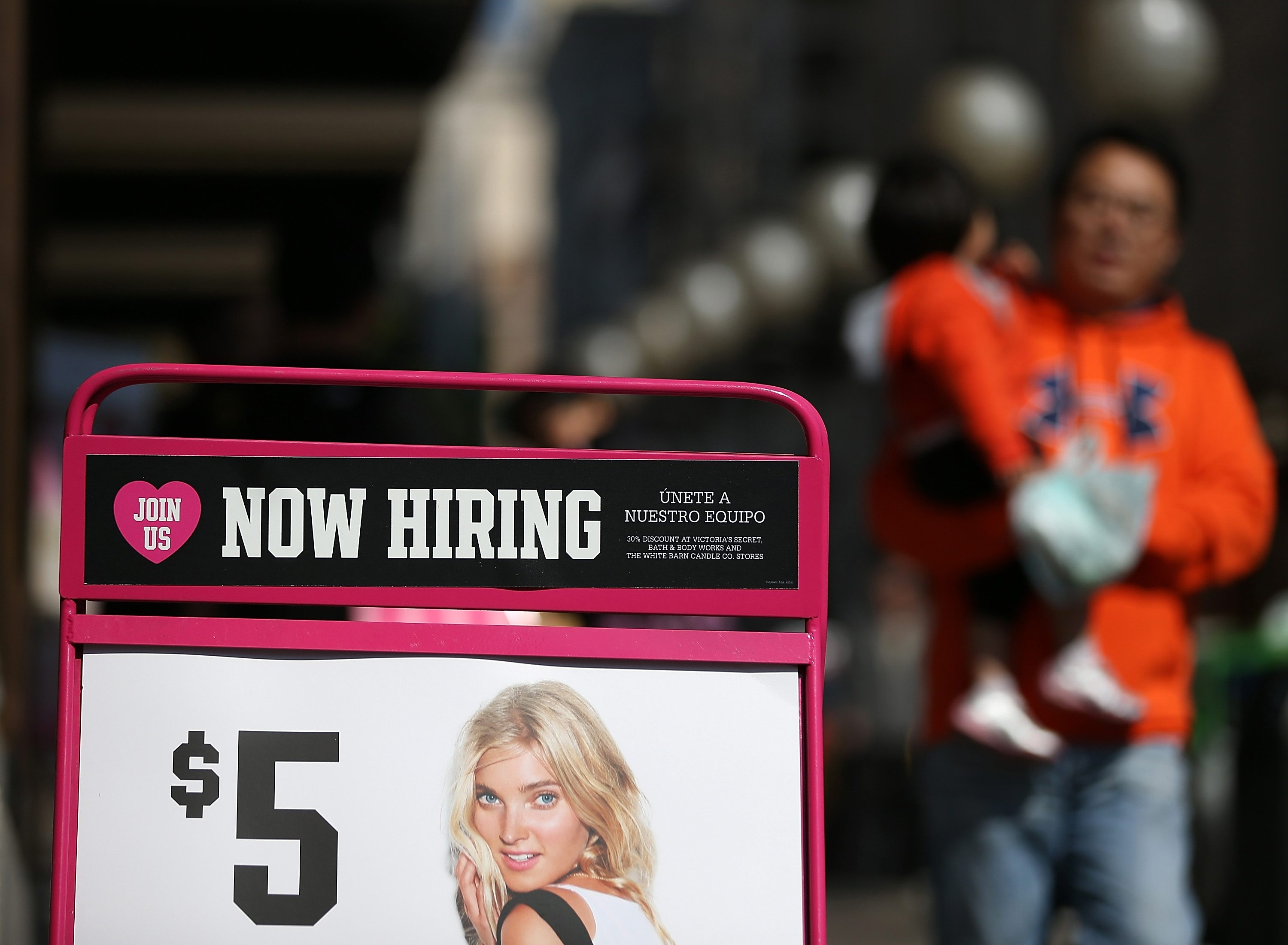 "SAN FRANCISCO, CA – SEPTEMBER 27:  A ""now hiring"" sign is posted in front of a clothing store on September 27, 2012 in San Francisco, California.  The Labor Department reported that new claims for unemployment benefits fell by 26,000 this week to a seasonally-adjusted 359,000, the lowest level since July. (Photo by Justin Sullivan/Getty Images)"
