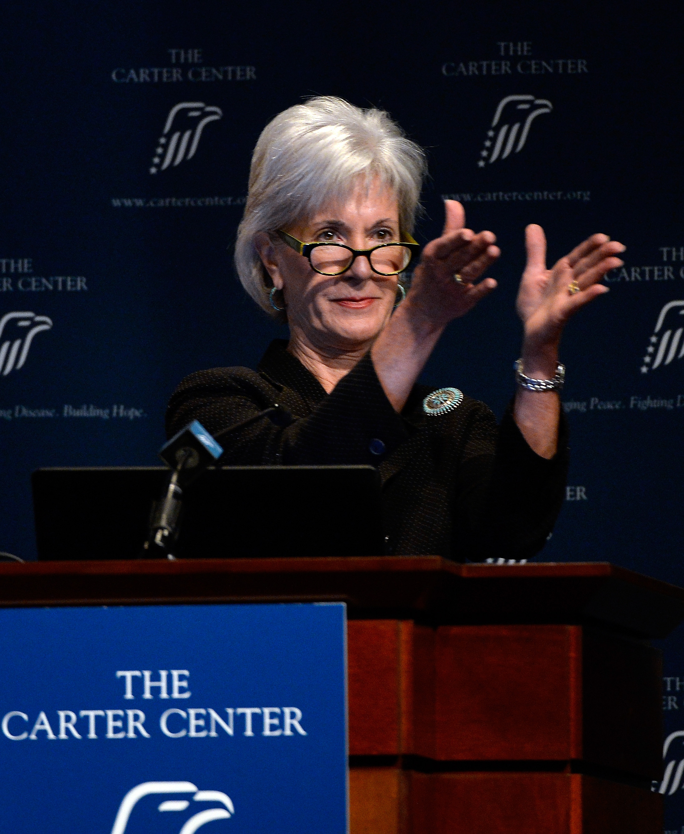 Health and Human Services Secretary Kathleen Sebelius applauds as she announces easier access to mental health care on Friday in Atlanta.