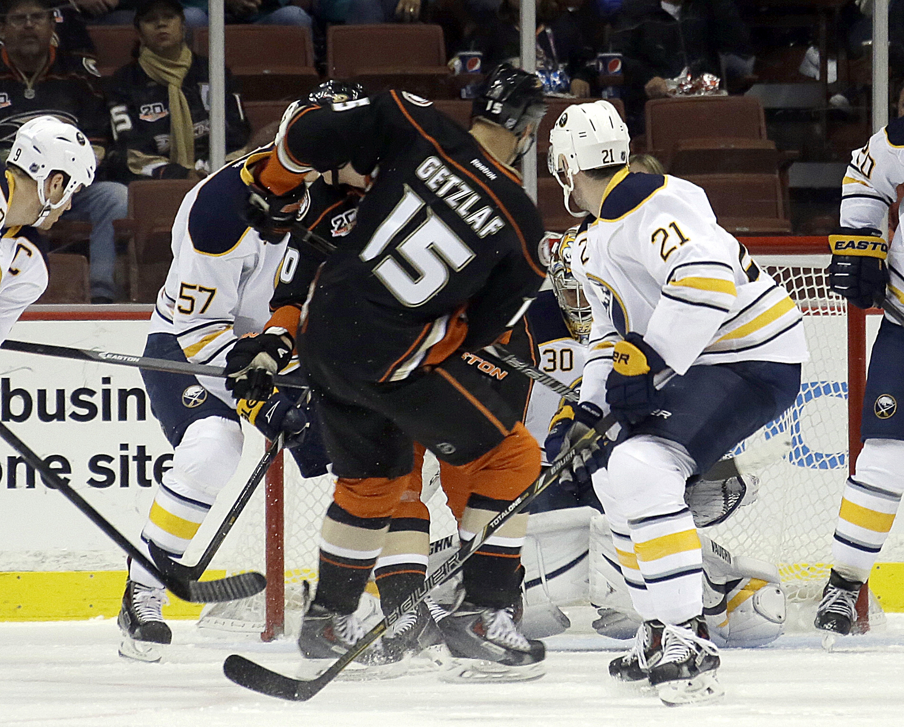 Anaheim Ducks center Ryan Getzlaf (15) fires through a crowd for his first of three goals in the first period against the Buffalo Sabres on Friday night at the Honda Center. (AP Photo/Reed Saxon)