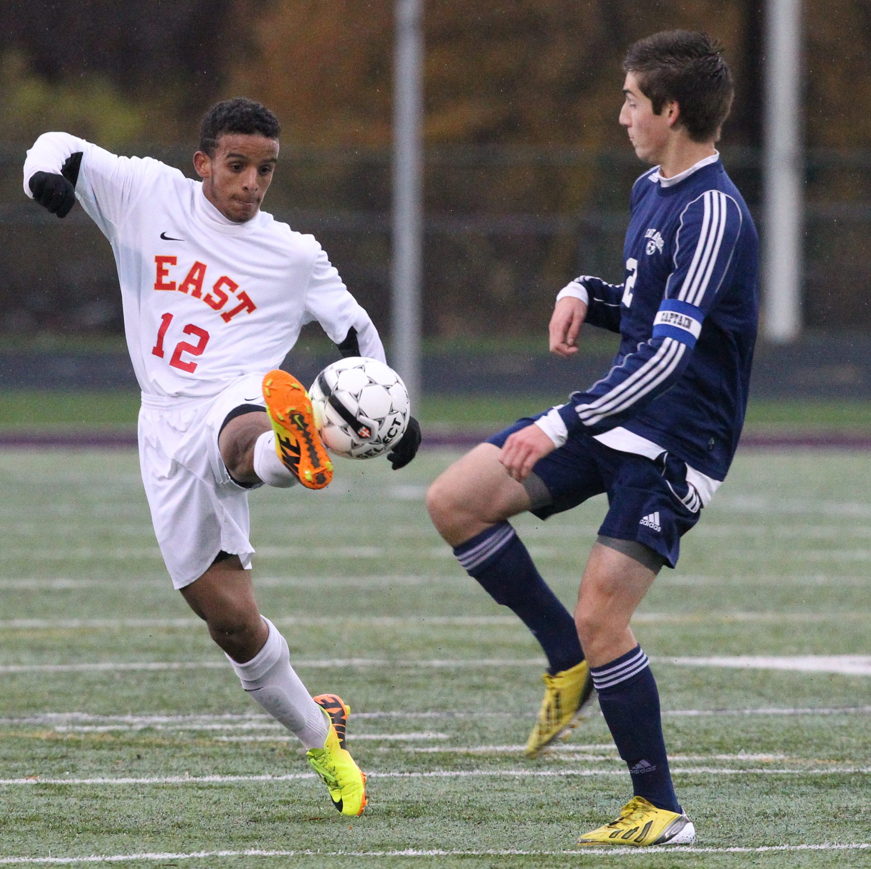 Williamsville East's Adam Ahmed battles East Aurora's Sean Kishel for the ball in the first half in the A game at Hamburg High School Saturday.