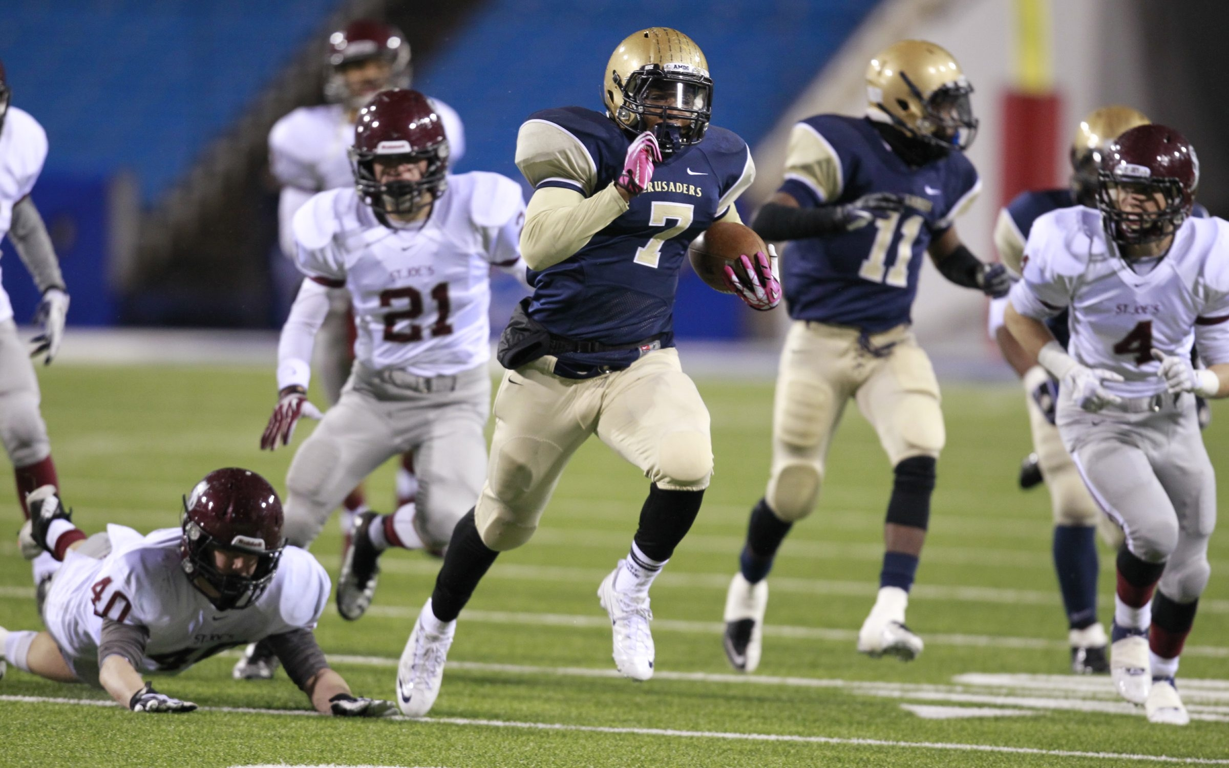 Canisius running back Qadree Ollison runs through St. Joe's defenders for a second-quarter touchdown. Ollison finished with five touchdowns and 240 yards on 20 carries.